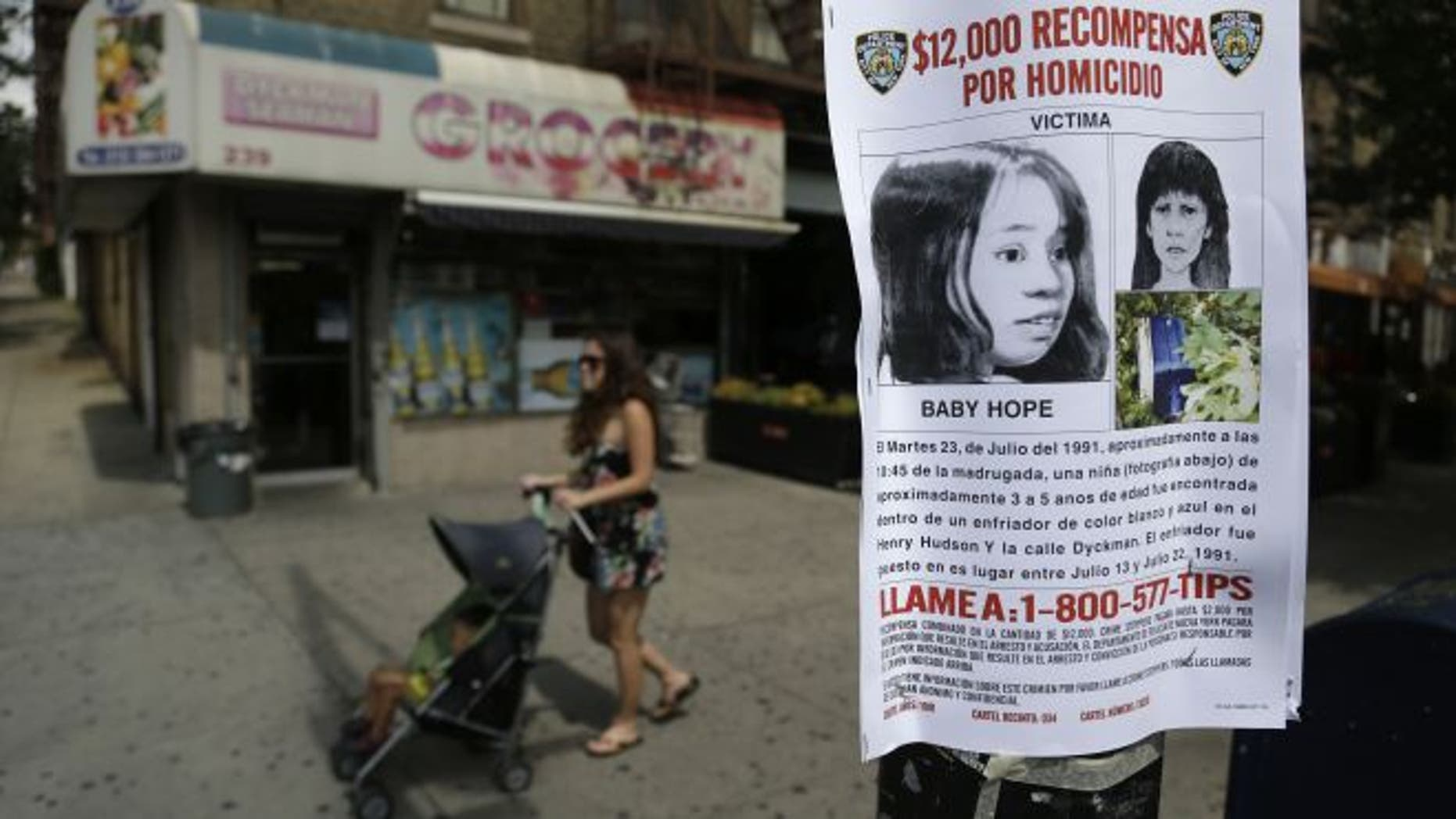 July 23, 2013: This photo shows a poster soliciting information regarding an unidentified body near the site where the body was found in New York. (AP)