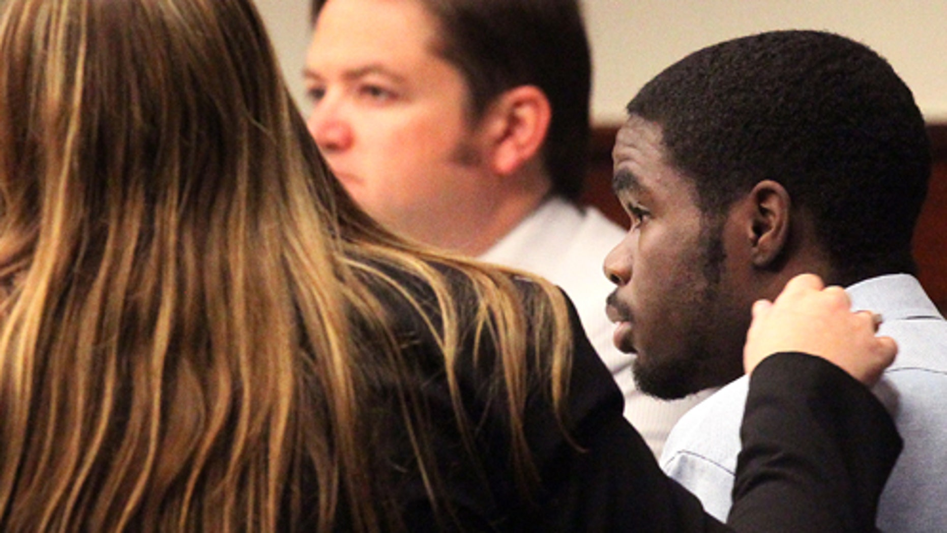 A member of the defense team put her hand on De'Marquise Elkins' shoulder as he was found guilty of all charges at Cobb Superior Court in Marietta, Ga. on Friday, Aug. 2013.  Jurors deliberated about two hours before finding  Elkins guilty of 11 counts, including two counts of felony murder and one count of malice murder in the March 21 killing of 13-month-old Antonio Santiago in Brunswick. The man's mother, Karimah Elkins, was on trial alongside him and was found guilty of tampering with evidence but acquitted of lying to police. De'Marquise Elkins faces life in prison when he is sentenced at a later date. At the time of the shooting he was 17, too young to face the death penalty under Georgia law.  (AP Photo/Atlanta Journal-Constitution, Phil Skinner)  MARIETTA DAILY OUT; GWINNETT DAILY POST OUT; LOCAL TV OUT; WXIA-TV OUT; WGCL-TV OUT