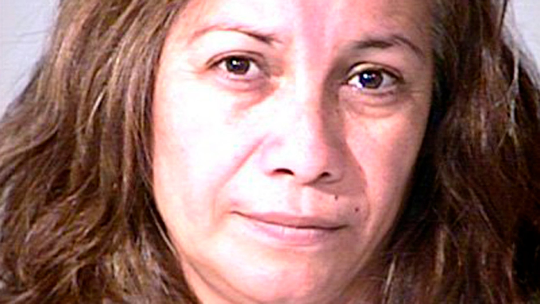 Aug. 6, 2012: In this photo provided by the Garden Grove, Calif., police, Grisel Ramirez, 48,  is seen in custody Monday.