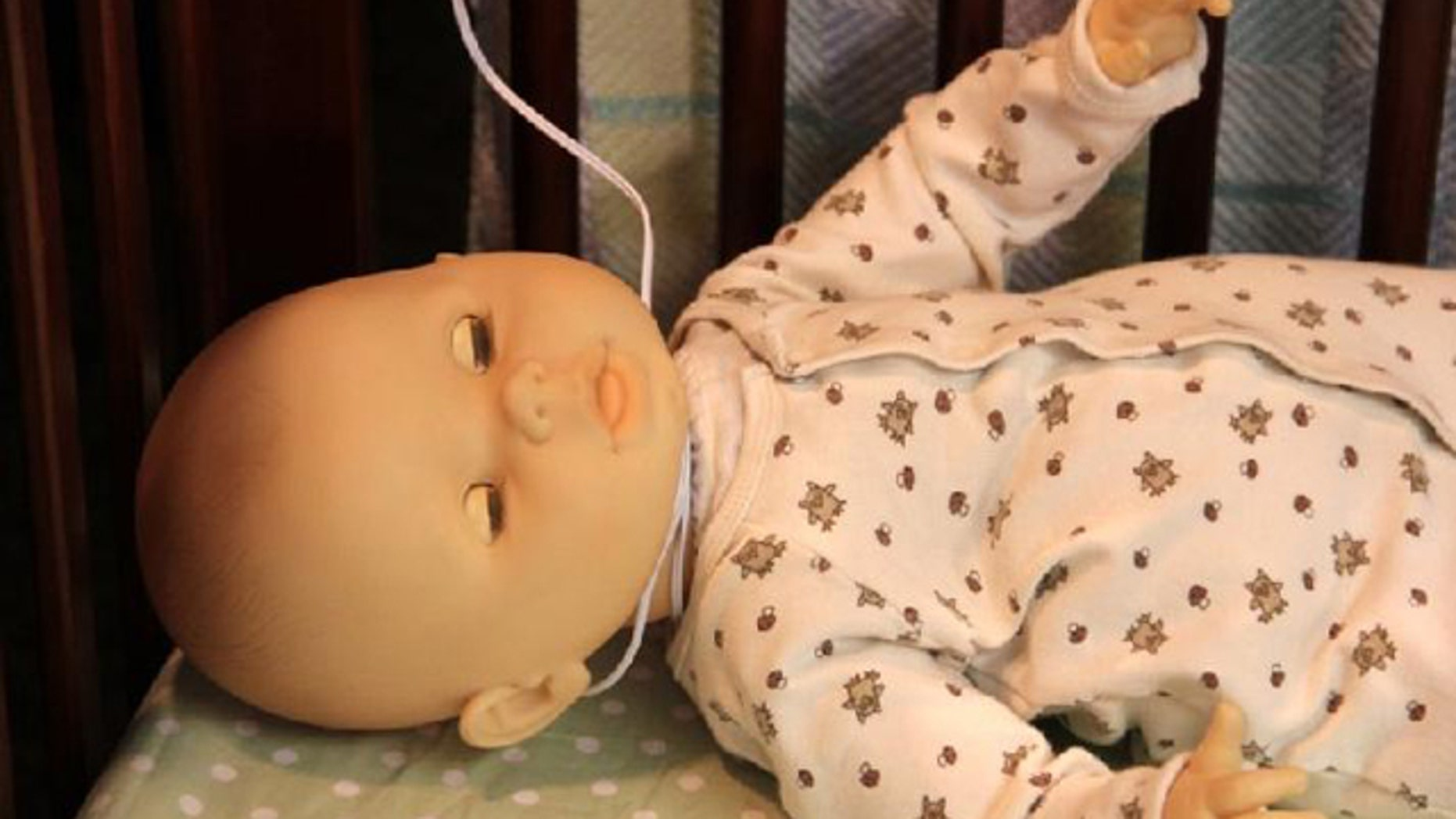This doll demonstrates how a baby may be strangled by video baby monitor cord.  The Consumer Product Safety Commission has recalled nearly 2 million video baby monitors after the death of two infants.