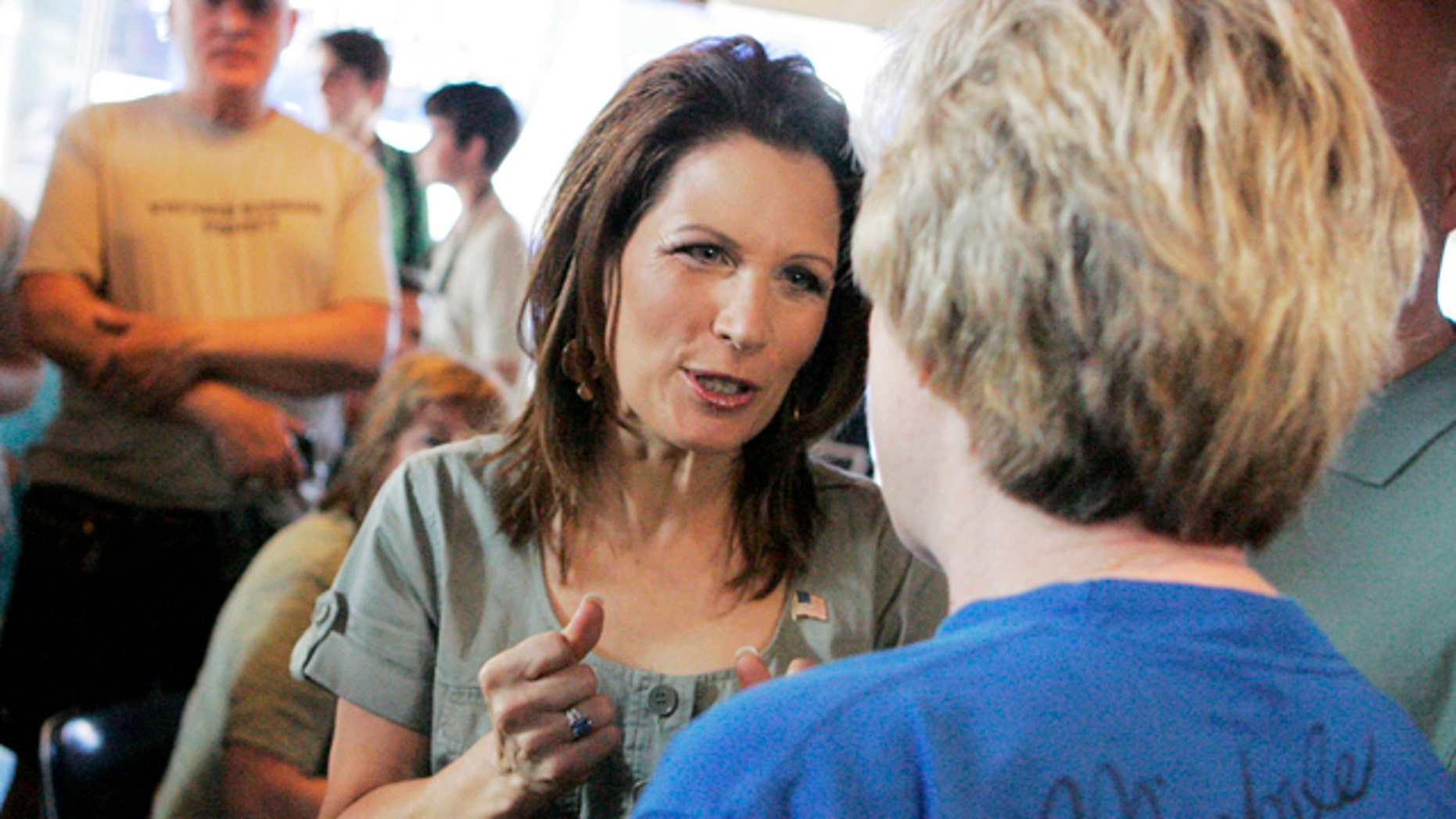 July 2: GOP presidential candidate Michele Bachmann speaks with a potential voter in Iowa City.