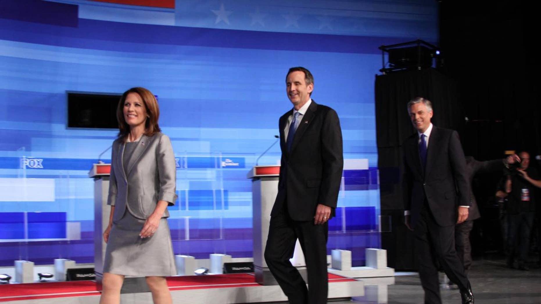 Candidates Michele Bachmann, Tim Pawlenty and Jon Huntsman take the stage at Thursday's Fox News, Washington Examiner, Iowa GOP presidential debate. (Fox News Photo)