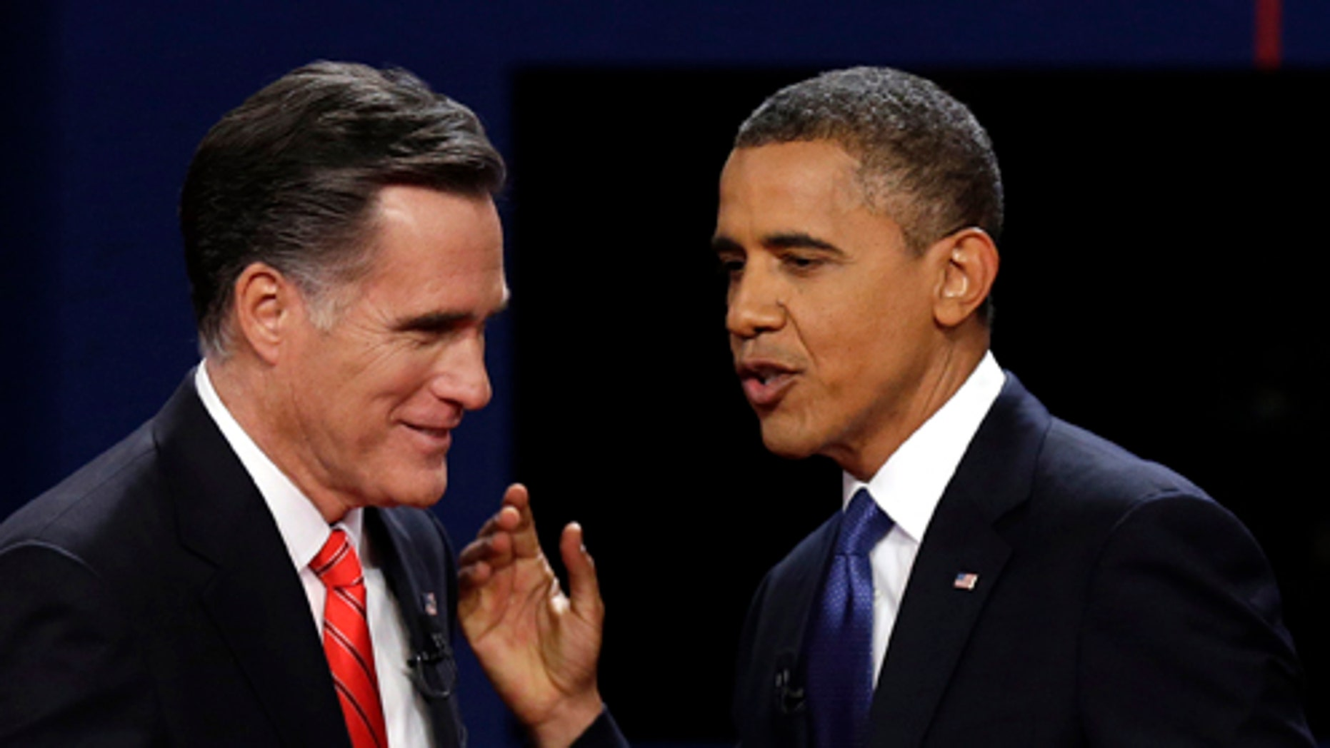 FILE - In this Oct. 3, 2012 file photo, Republican presidential candidate former Massachusetts Gov. Mitt Romney and President Barack Obama talk after the first presidential debate at the University of Denver in Denver. The razor-thin race for the White House has overshadowed the fight for control of Congress. But the stakes are high in the Senate contests. With Republicans expected to retain control of the House of Representatives, a Republican Senate would give the party full control of the U.S. government if Romney wins the presidency. If Obama is re-elected, he hopes to have a Democratic-controlled Senate to counteract the Republican House, advance his agenda and defend his signature legislative victory, his health care overhaul, which Republicans have vowed to repeal. (AP Photo/Charlie Neibergall, File)