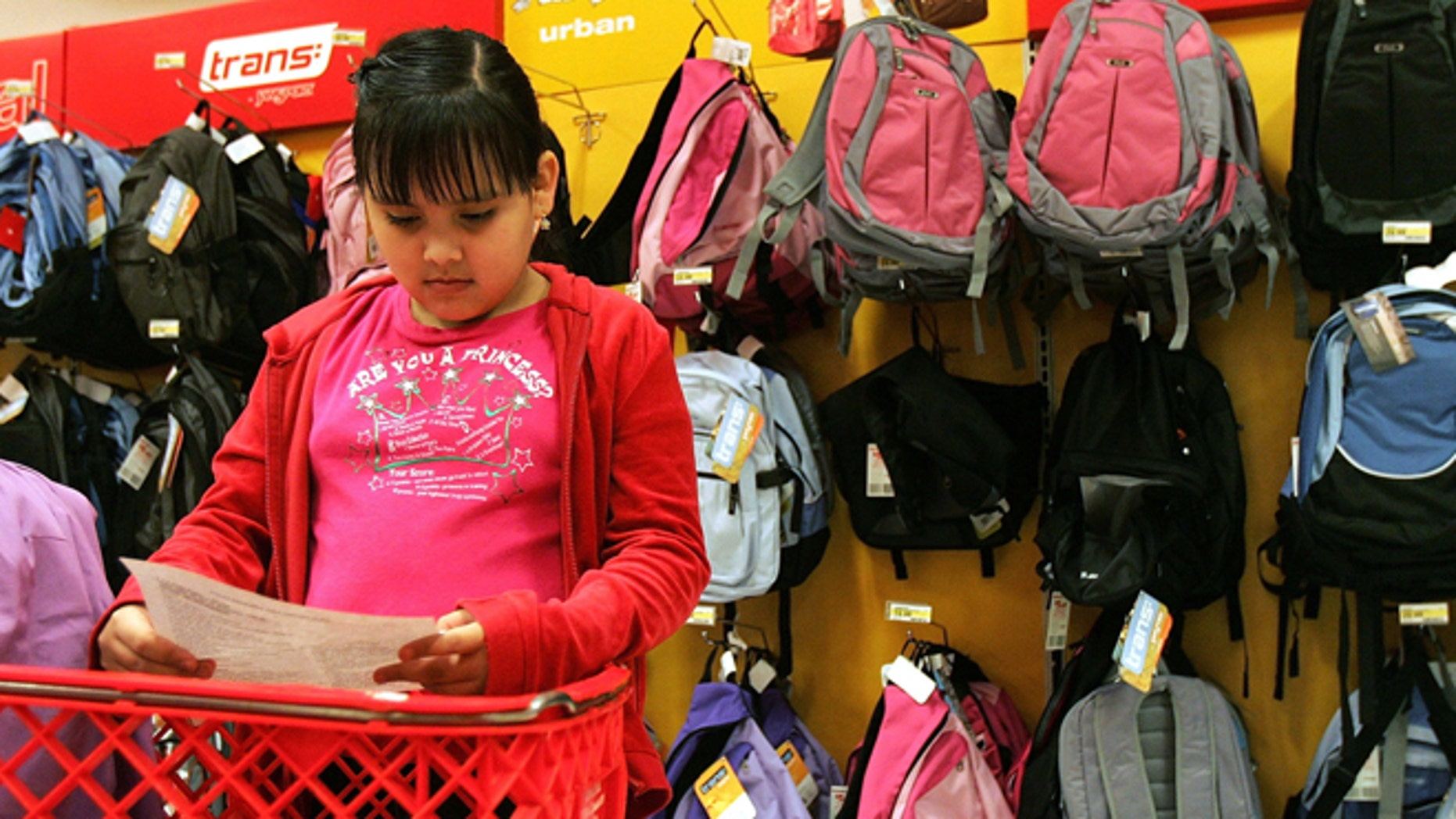ROSEMONT, IL - AUGUST 11:  Patricia Zaragoza, 9, checks her back-to-school shopping list at a Target store August 11, 2005 in Rosemont, Illinois. With the start of school nearing, retailers are stocking up in anticipation of back-to-school shoppers.  (Photo by Tim Boyle/Getty Images)
