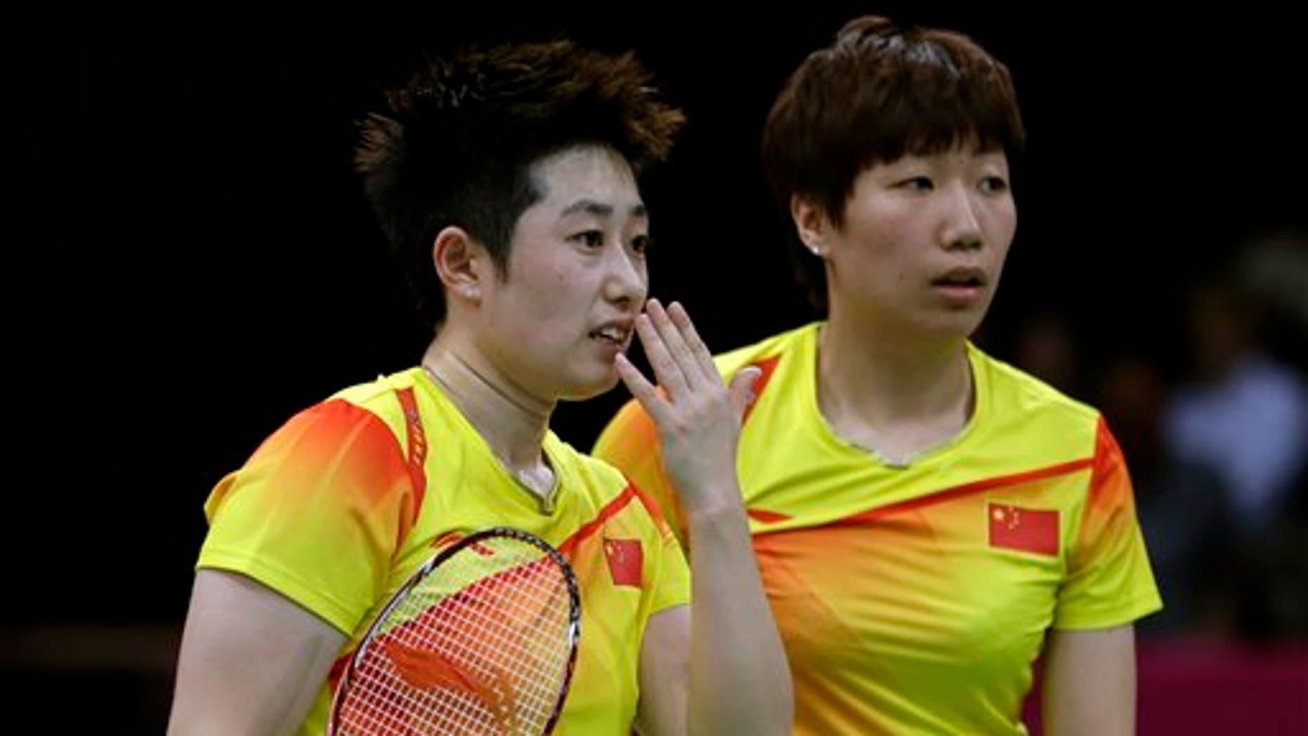 July 31, 2012: China's Yu Yang, left, and Wang Xiaoli talk while playing against Jung Kyun-eun and Kim Ha-na, of South Korea, in a women's doubles badminton match at the 2012 Summer Olympics.