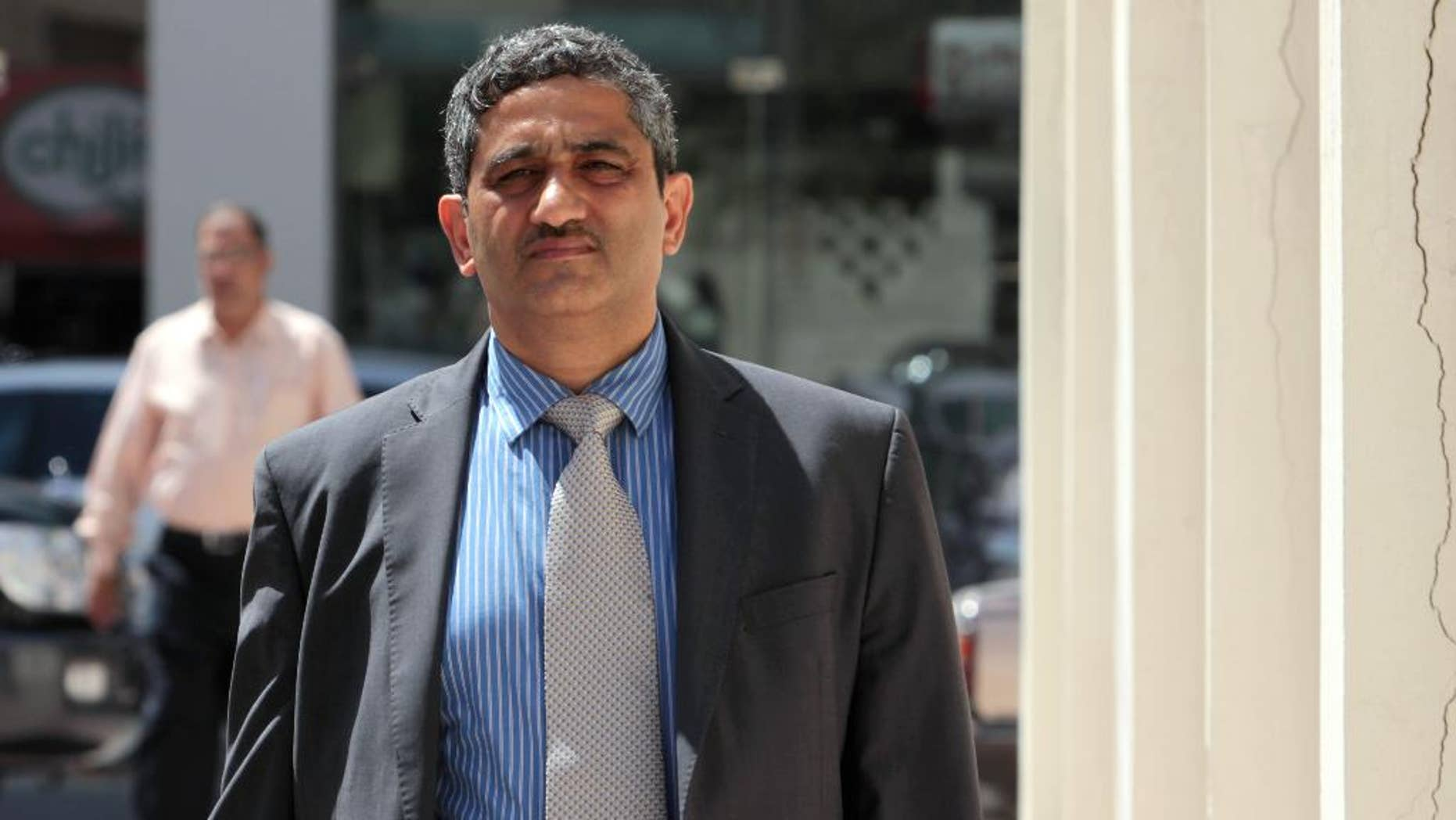 """FILE - In this May 18, 2011, file photo, Mansour al-Jamri, former chief editor of the Bahraini opposition newspaper Al Wasat, arrives at the courthouse in Manama, Bahrain. The official Bahrain News Agency said in a brief statement issued Thursday, Aug. 6, 2015, that the suspension of the publication of the independent newspaper Al-Wasat. is """"due to its violation of the law and repeated dissemination of information that affects national unity and the Kingdom's relationship with other countries."""" (AP Photo/Hasan Jamali, File)"""