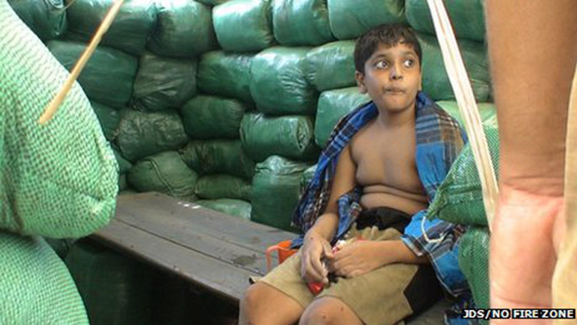 Balachandran Prabhakaran, shown eating chocolate while sitting on a bench.