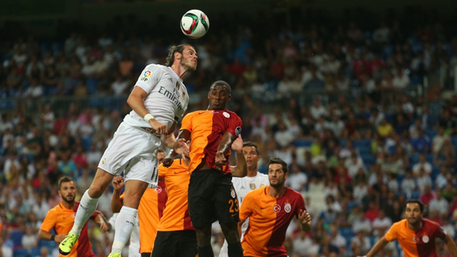 Real Madrid's Gareth Bale, top left, goes for a header with Galatasaray's Lionel Carole, top right, during the Santiago Bernabeu trophy soccer match between Real Madrid and Galatasaray at the Santiago Bernabeu stadium, in Madrid, Spain, Tuesday, Aug. 18, 2015. (AP Photo/Francisco Seco)