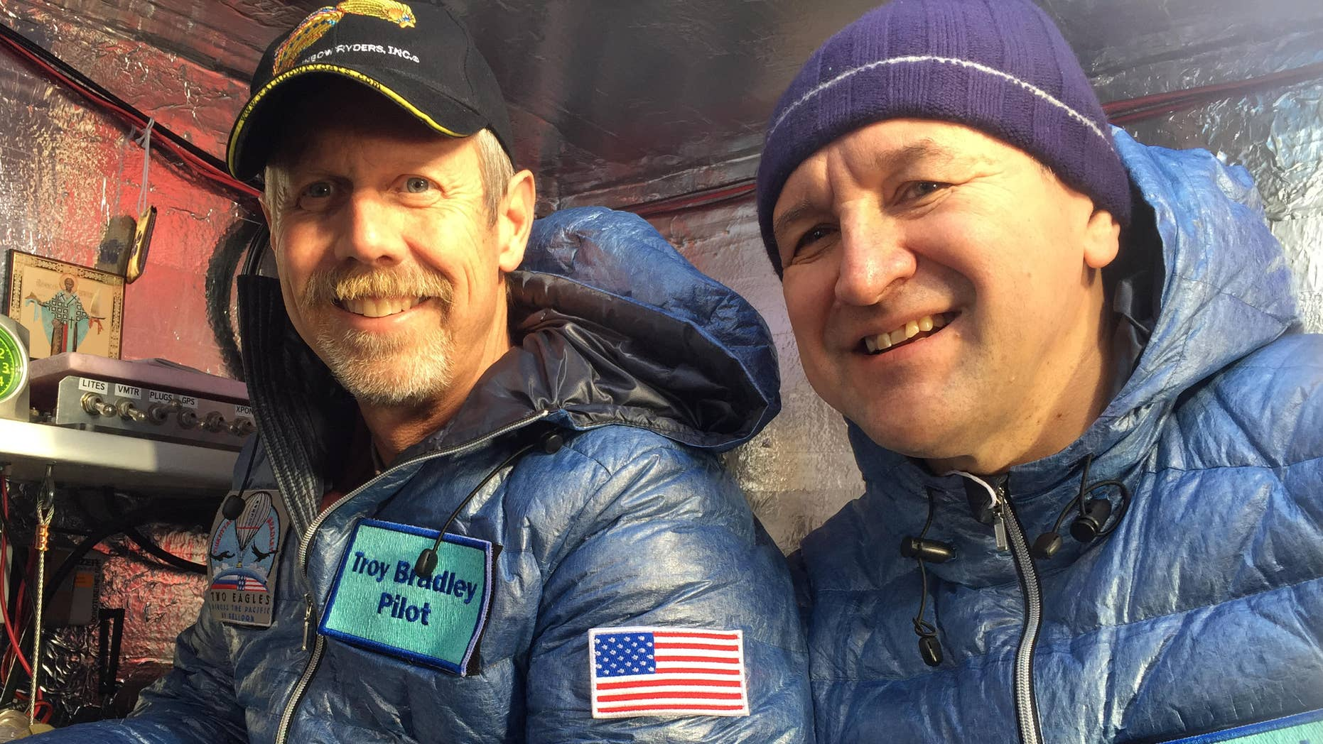 Jan. 8, 2015: pilots from left, Troy Bradley of Albuquerque, N.M., and Leonid Tiukhtyaev of Russia, before they lift off in a gas balloon in Saga, Japan.