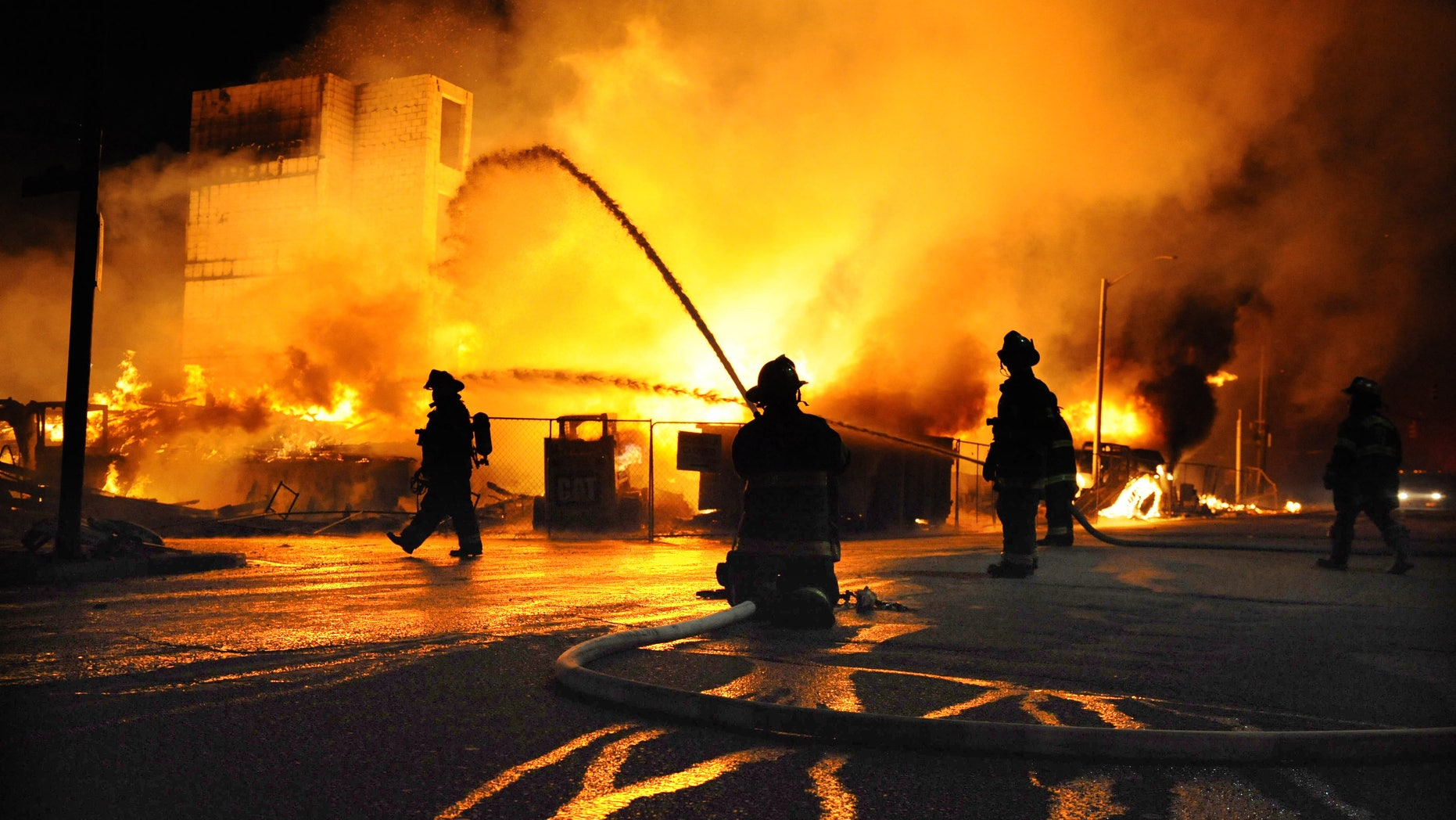 Baltimore firefighters battle a three-alarm fire Monday, April 27, 2015,  at a senior living facility under construction at Federal and Chester Streets in East Baltimore.