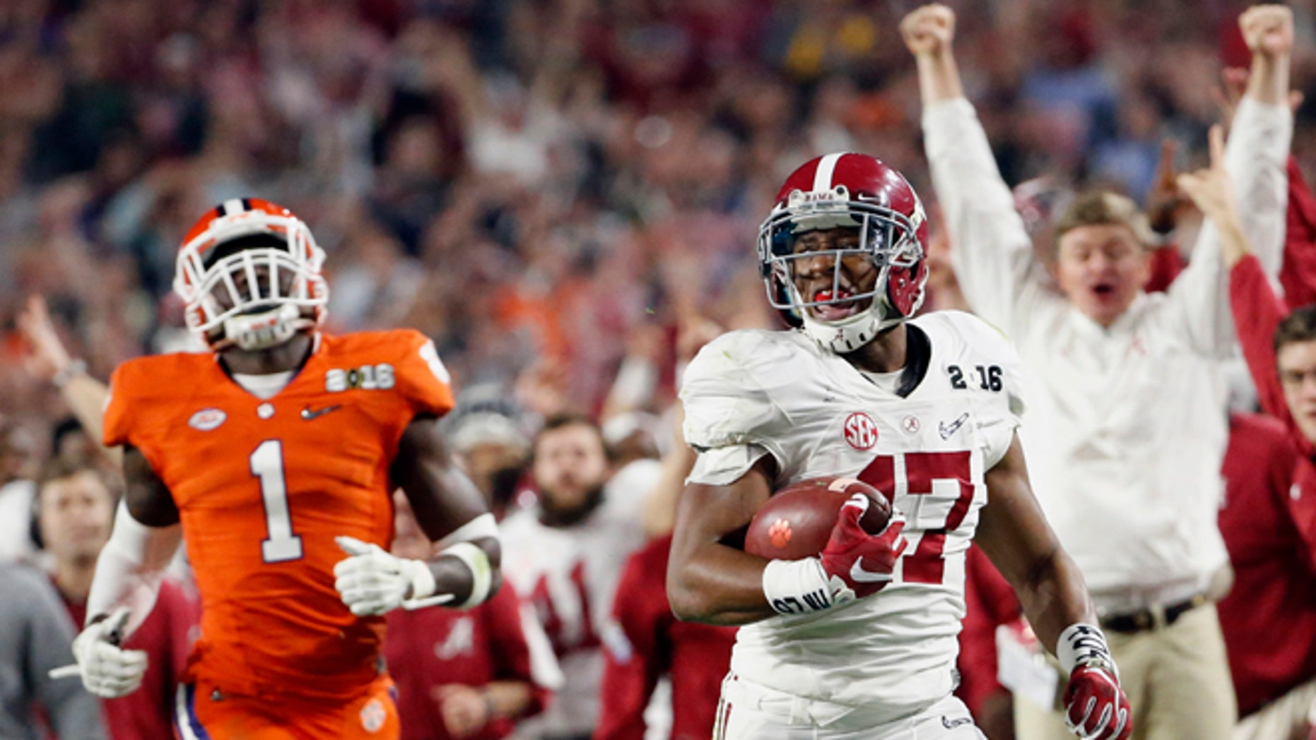 Alabama's Kenyan Drake, right, breaks away for a touchdown return against Clemson's Jayron Kearse (1) during the second half of the NCAA college football playoff championship game Monday, Jan. 11, 2016, in Glendale, Ariz. (Michael Chow/The Arizona Republic via AP) MARICOPA COUNTY OUT; MAGS OUT; NO SALES; MANDATORY CREDIT