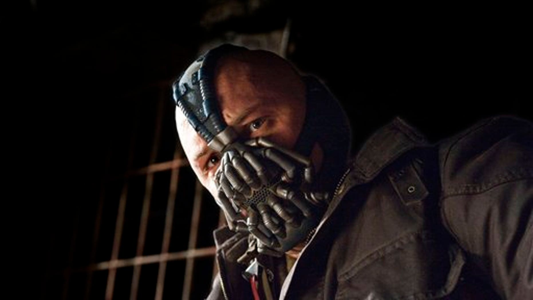 "This undated film image released by Warner Bros. Pictures shows Tom Hardy as Bane in a scene from the action thriller ""The Dark Knight Rises."""