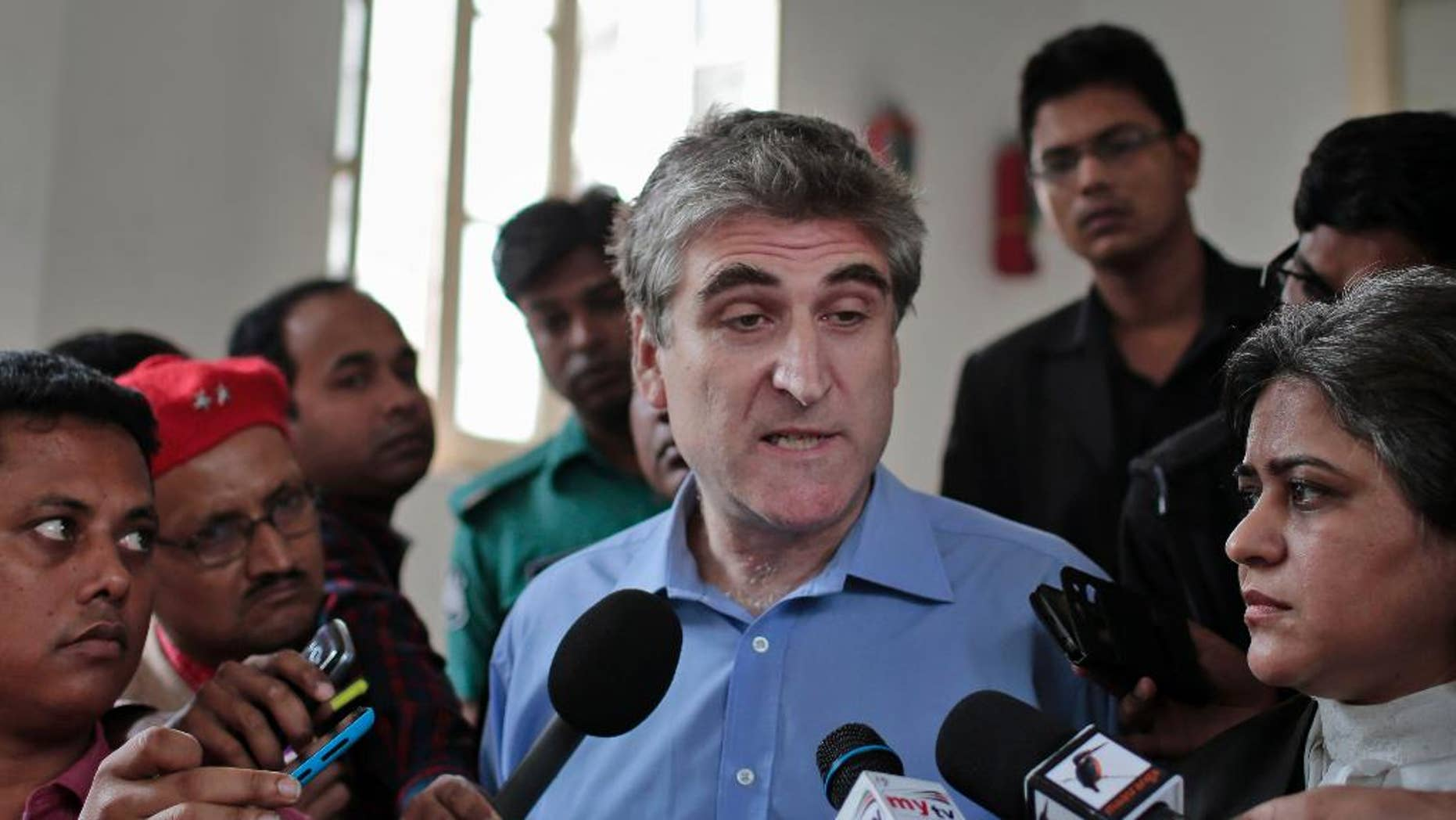 British journalist David Bergman speaks to journalists outside the International Crimes Tribunal court building in Dhaka, Bangladesh, Tuesday, Dec. 2, 2014. A court in Bangladesh dealing with war crimes committed during Bangladesh's 1971 war of independence has found Bergman guilty of contempt for questioning the official death toll of that conflict. (AP Photo/A.M. Ahad)