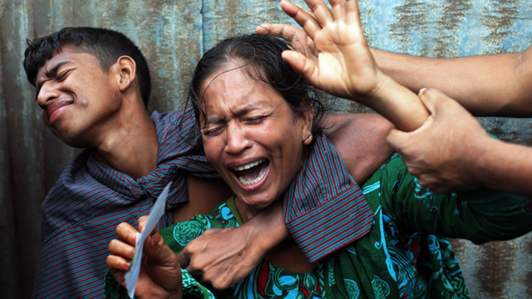 Aug. 4, 2014: Bangladeshi woman Munni, whose daughters are missing, cries as rescuers search the River Padma after a passenger ferry capsized in Munshiganj district, Bangladesh. (AP)