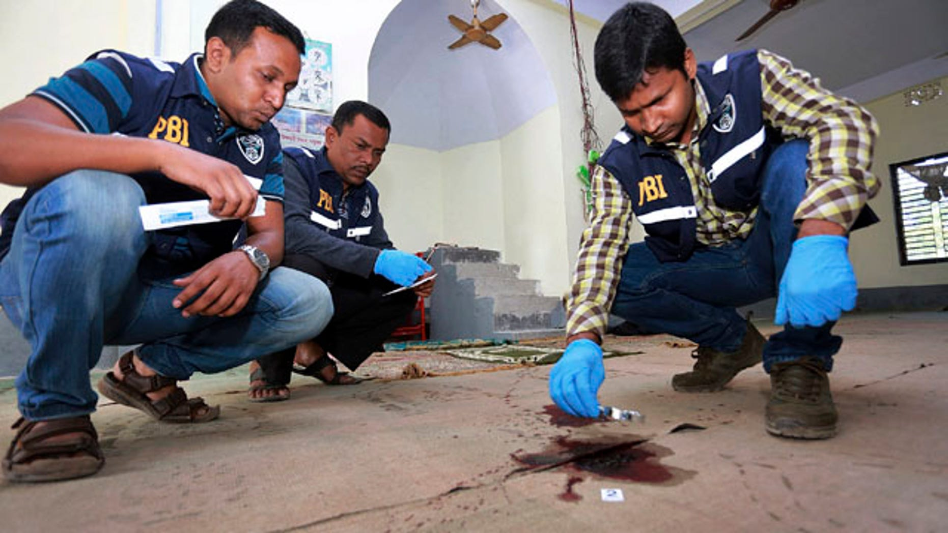 Nov. 27, 2015: Investigators inspect a mosque that was attacked by unidentified gunmen during evening prayers on Thursday in northern Bangladesh's Bogra district. (AP Photo)
