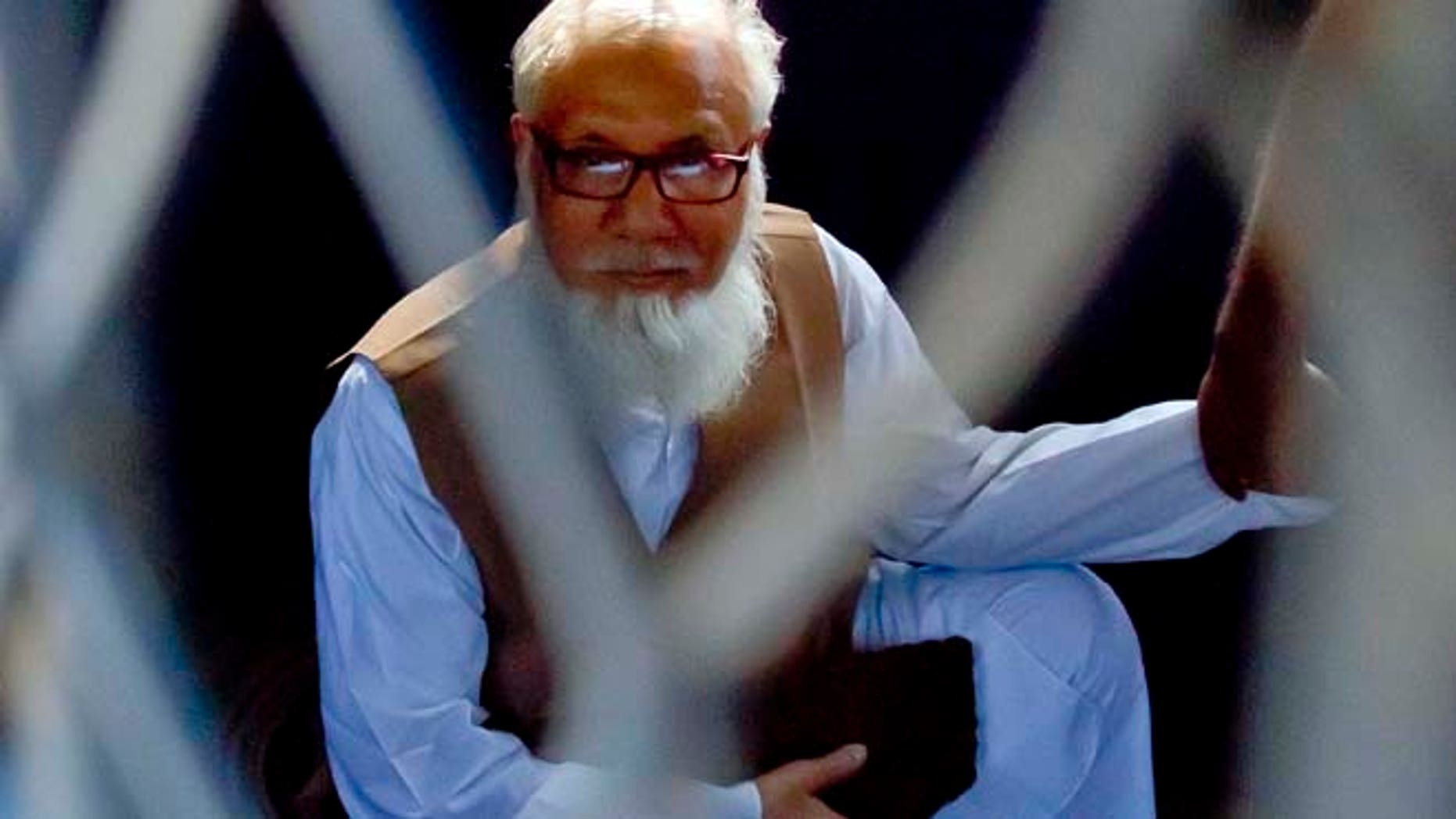 Oct. 29, 2014: Jamaat-e-Islami chief Motiur Rahman Nizami sits inside a police van after he was sentenced to death for his role in the deaths of thousands of people during the nation's independence war against Pakistan in 1971, in Dhaka, Bangladesh. (AP)