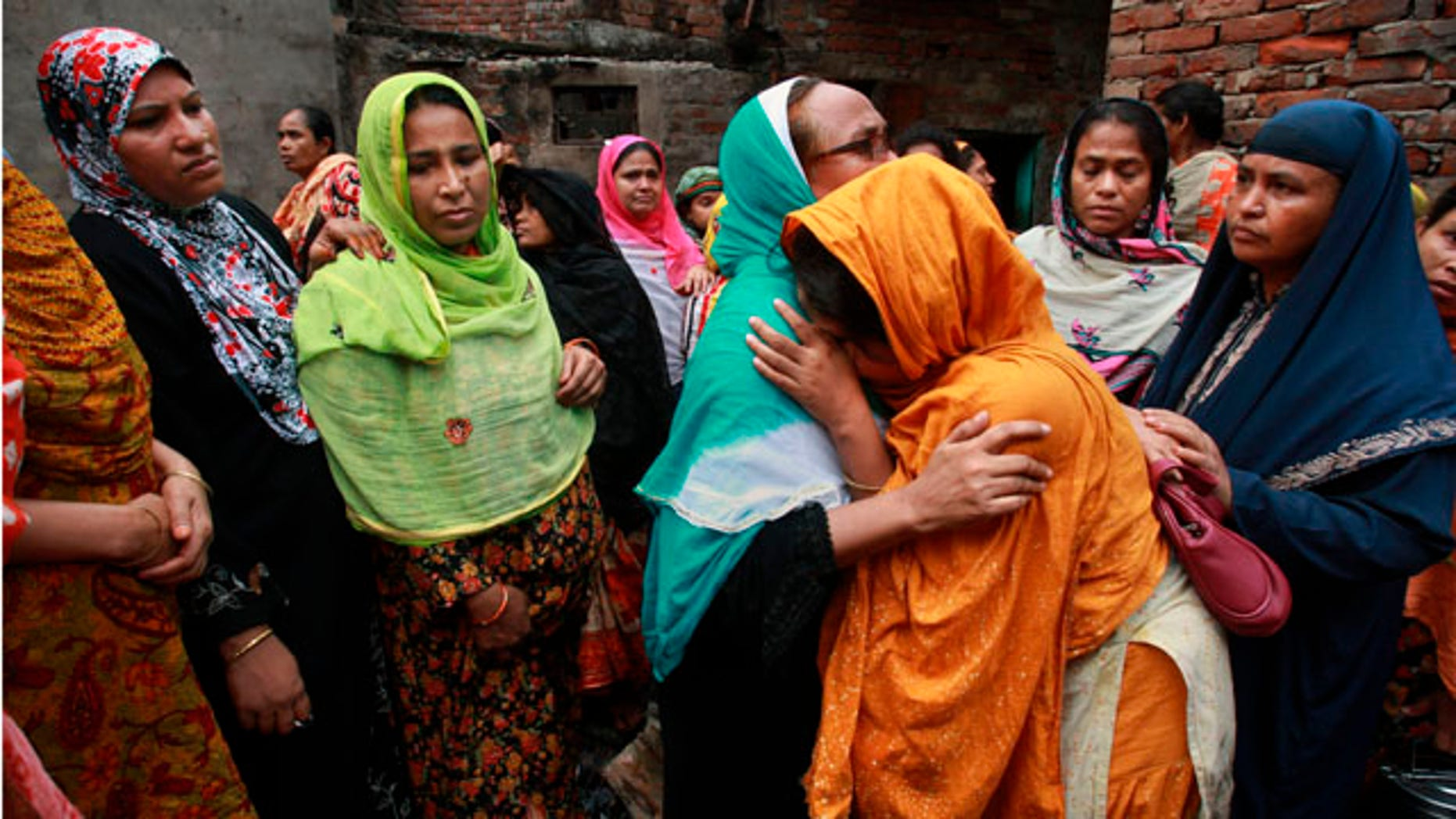 June 4: Relatives mourn the death of a victim of a fire in Dhaka, Bangladesh. The devastating fire raced through several apartment complexes in the Bangladeshi capital Thursday, killing and injuring scores of people. (AP)