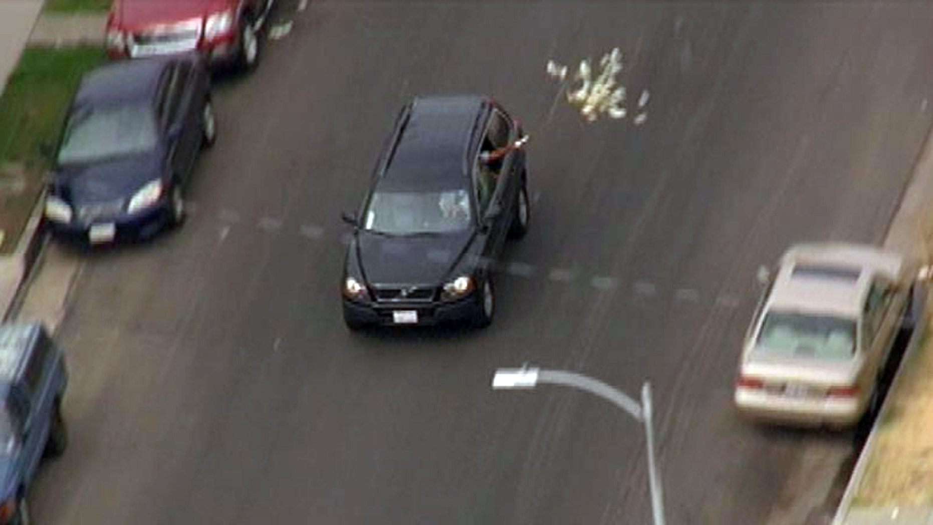 Sept. 12, 2012: Bank robbery suspects throw money from their vehicle during a police pursuit.