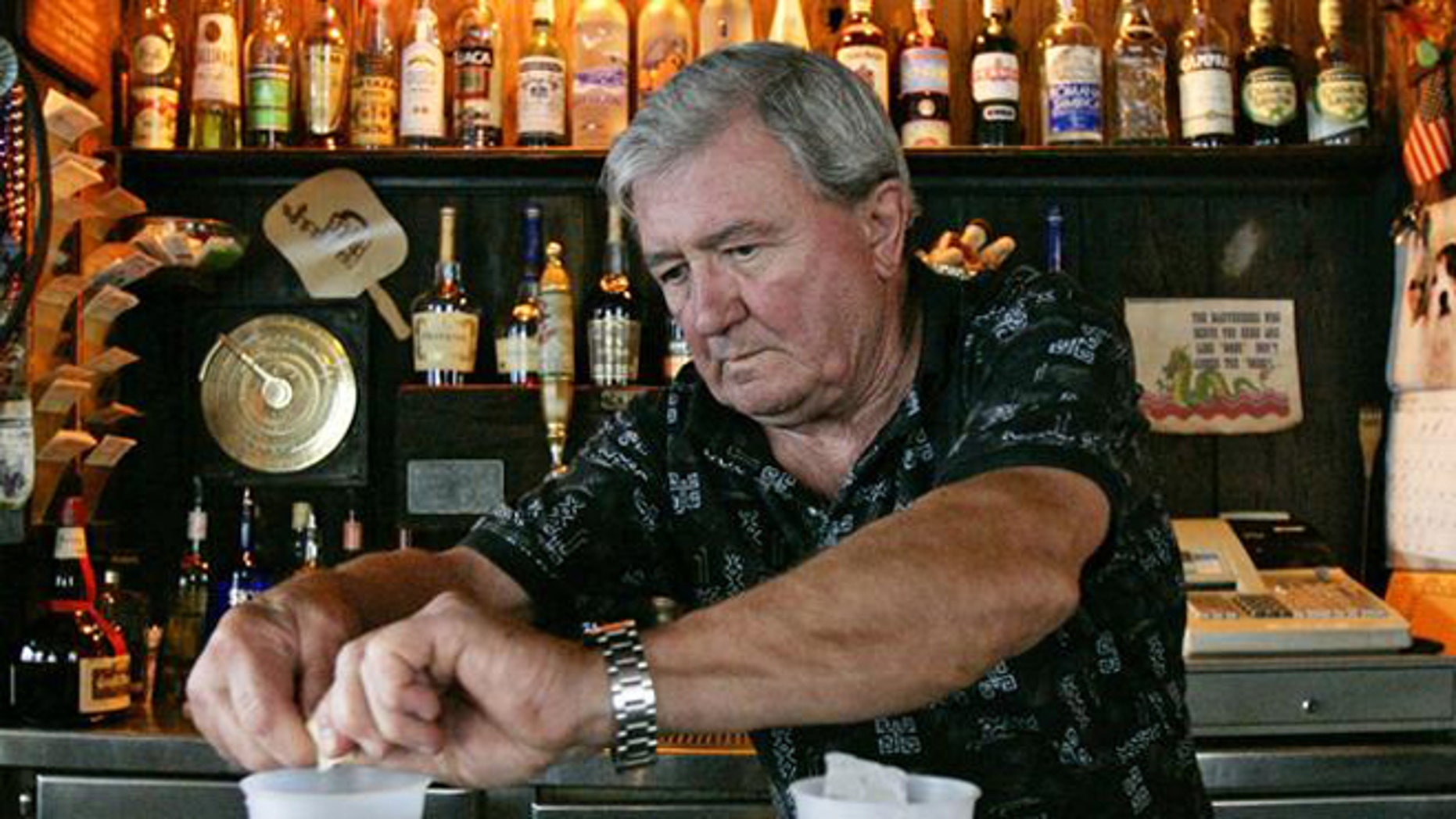 Ray Newman, owner of The Chart Room bar prepares a couple of cocktails after cleaning his bar in preparation to re-opening it in the French Quarter district Thursday, Sept. 29, 2005, in New Orleans. A month after Hurricane Katrina hit the Gulf Coast, New Orleans Mayor Ray Nagin invited business owners back into the city, and prepared to allow most residents to return over the next week. (AP Photo/Kevork Djansezian)