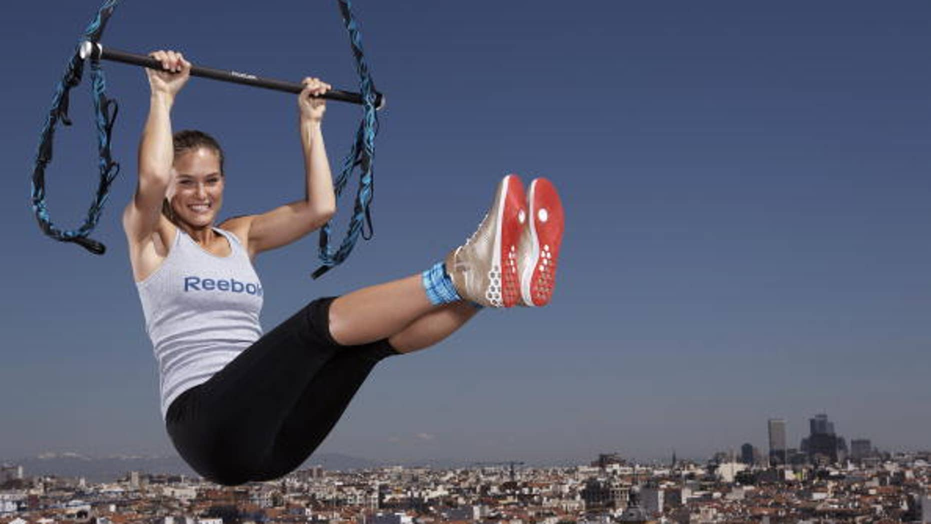 MADRID- SPAIN - MAY 6:  (ONLY AVAILABLE FOR USE IN EUROPE , ISRAEL, UAE  & SOUTH AFRICA) Supermodel Bar Refaeli launches Reebok's and Cirque du Soleils revolutionary new workout for women, 'Jukari Fit to Fly', at a media event on May 6, 2009 in Madrid, Spain.  (Photo by Gary Prior/Getty Images for Reebok)