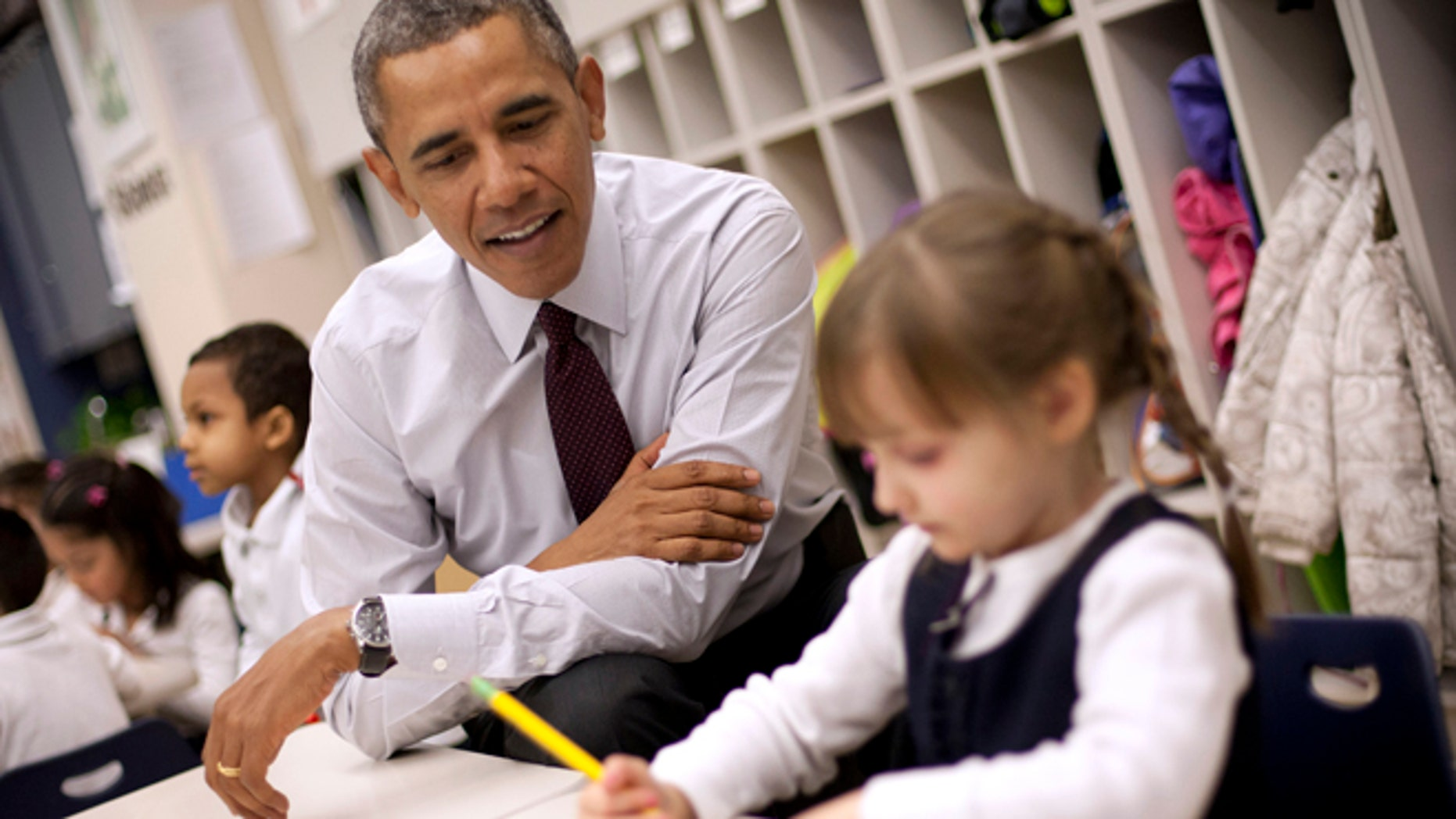 President Barack Obama sits with Emily Hare as she completes her spelling lessons during his visit to a preschool classroom at Powell Elementary School in the Petworth neighborhood of Washington, Tuesday, March 4, 2014. Obama visited the school to talk about his 2015 budget proposal, which was released today. Powell elementary has seen rapid growth in recent years and serves a predominantly Hispanic student body. Washington DC Mayor Vincent Gray, who greeted Obama at the school, recently directed $20 million to Powell for a planned modernization and addition. (AP Photo/Pablo Martinez Monsivais)