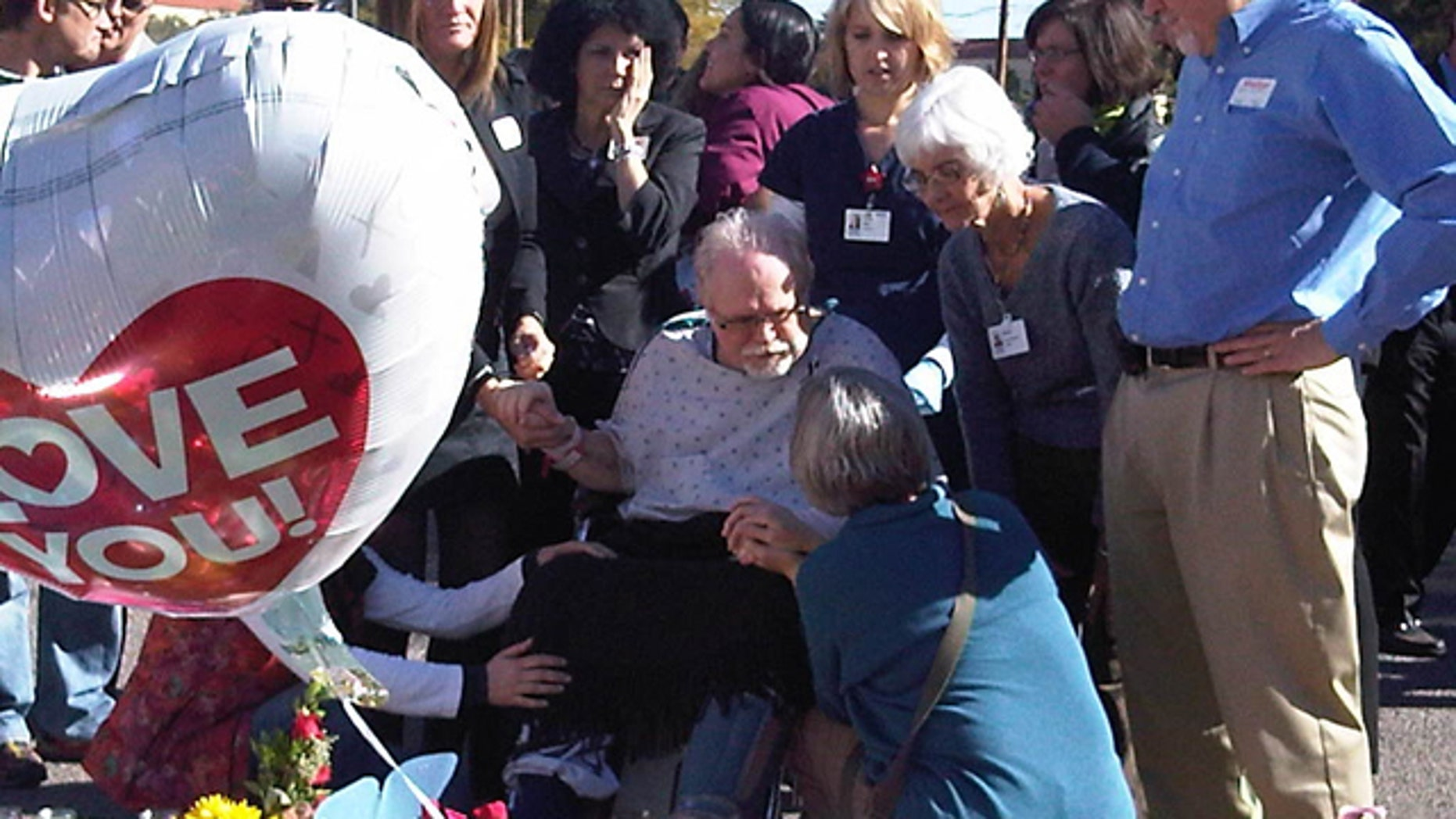 Jan. 13: Ron Barber, an aide to Giffords who was shot in the cheek, leaves the hospital for the first time to visit well-wishers and view a makeshift memorial.