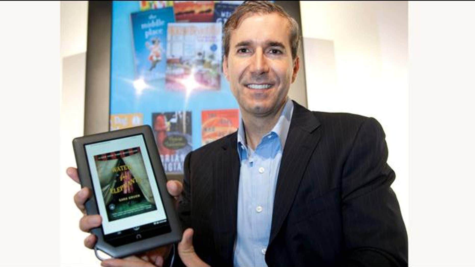 William Lynch, Chief Executive Officer of Barnes & Noble, holds the new NOOKcolor, the first full-color touch reader's tablet, prior to its introduction in New York on Tuesday, October 26, 2010. Designed to read many types of content, NOOKcolor has a 7-inch display that showcases books, a large selection of magazines and newspapers and children's picture books in rich color.