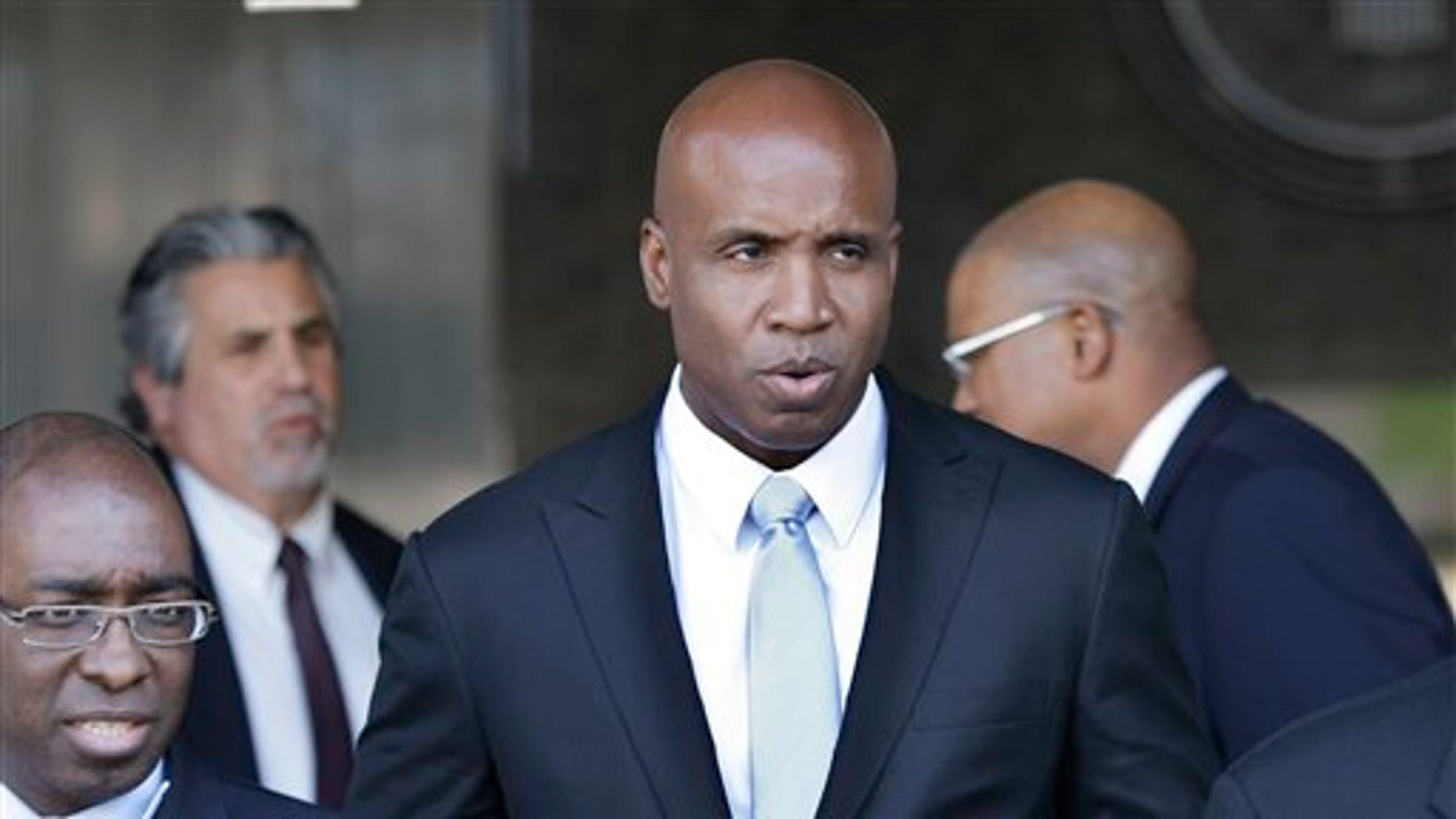 April 6: Barry Bonds leaves a federal courthouse for his trial in  San Francisco, CA. Bonds' confident defense team rested its case Wednesday without calling a single witness, just minutes after a federal judge accepted the government's request to dismiss one of the five counts against him.