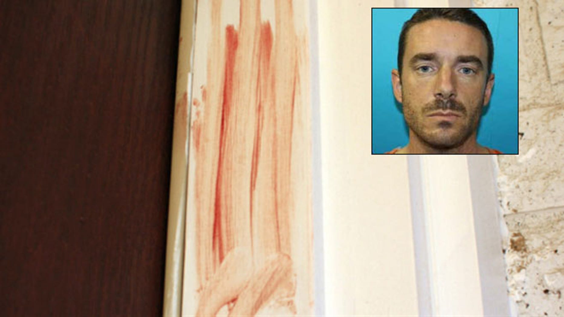 Dec. 12, 2012: Blood is smeared on the door frame at a home in Richland Hills, Texas, where Brent Troy Bartel is accused of using a box cutter to carve a pentagram in his six-year-old son's back.