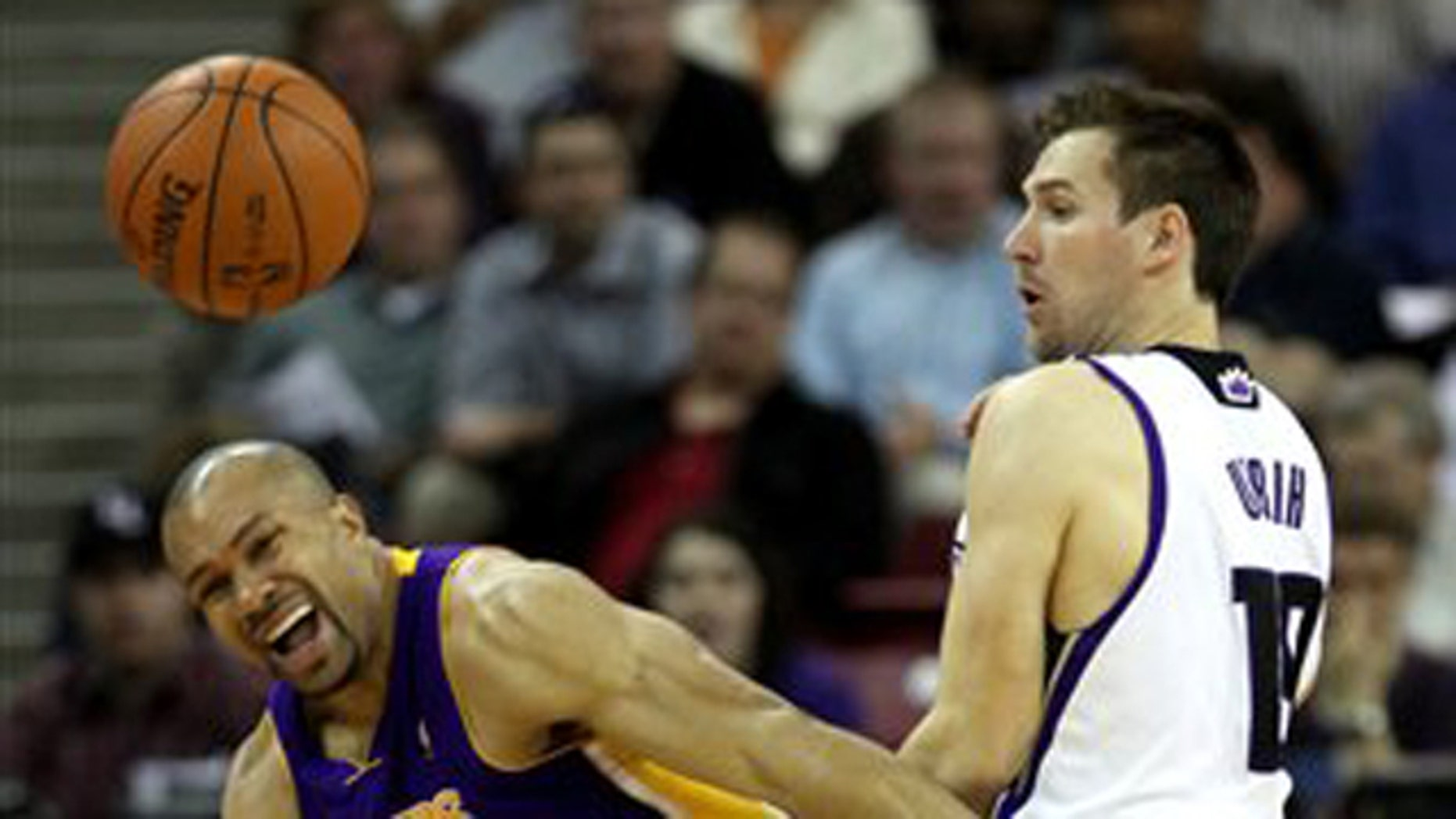 Los Angeles Lakers guard Derek Fisher, left, and Sacramento Kings guard Beno Udrih, of Slovenia collide during the a game in Sacramento.