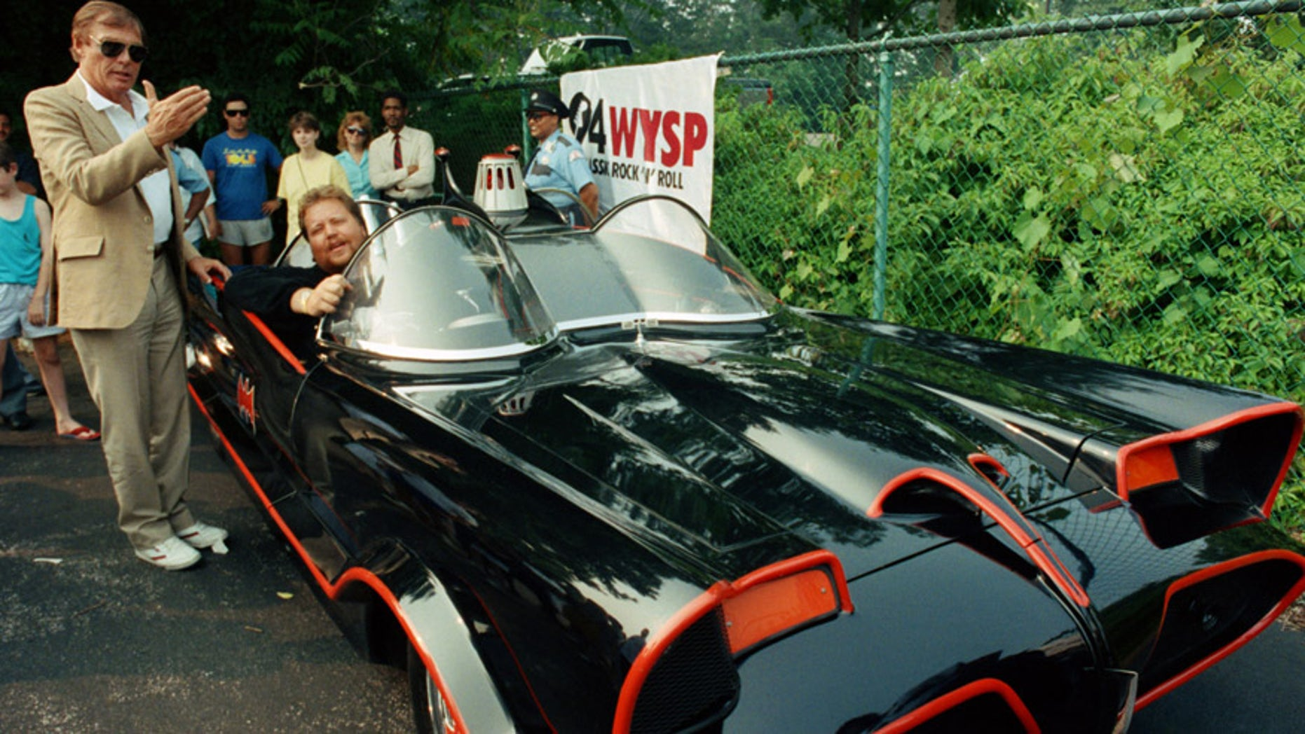 FILE - In this June 27, 1989 file photo, the original Batman, Adam West, left, stands beside the old Batmobile driven by owner Scott Chinery in Philadelphia. Batman won't have to worry about Batmobile knockoffs after a federal appeals court ruled the caped crusader's vehicle is entitled to copyright protection. The 9th U.S. Circuit Court of Appeals said Wednesday, Sept. 23, 2015, the Batmobile's bat-like appearance and other distinct traits make it a character that can't be replicated without permission from DC Comics, the copyright holder.   (AP Photo/Cristy Rickard, File)