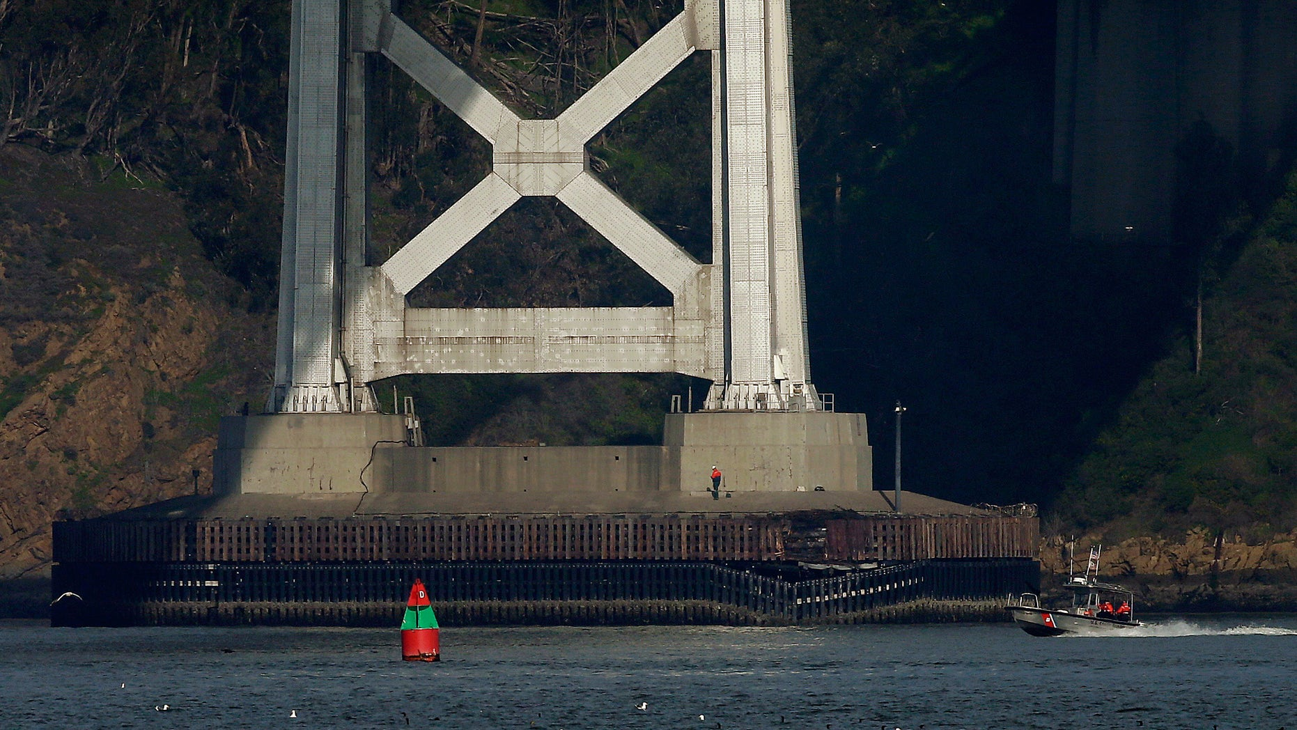 Jan. 7, 2013: A worker inspects damage to the bottom of a tower on the San Francisco-Oakland Bay Bridge in San Francisco.