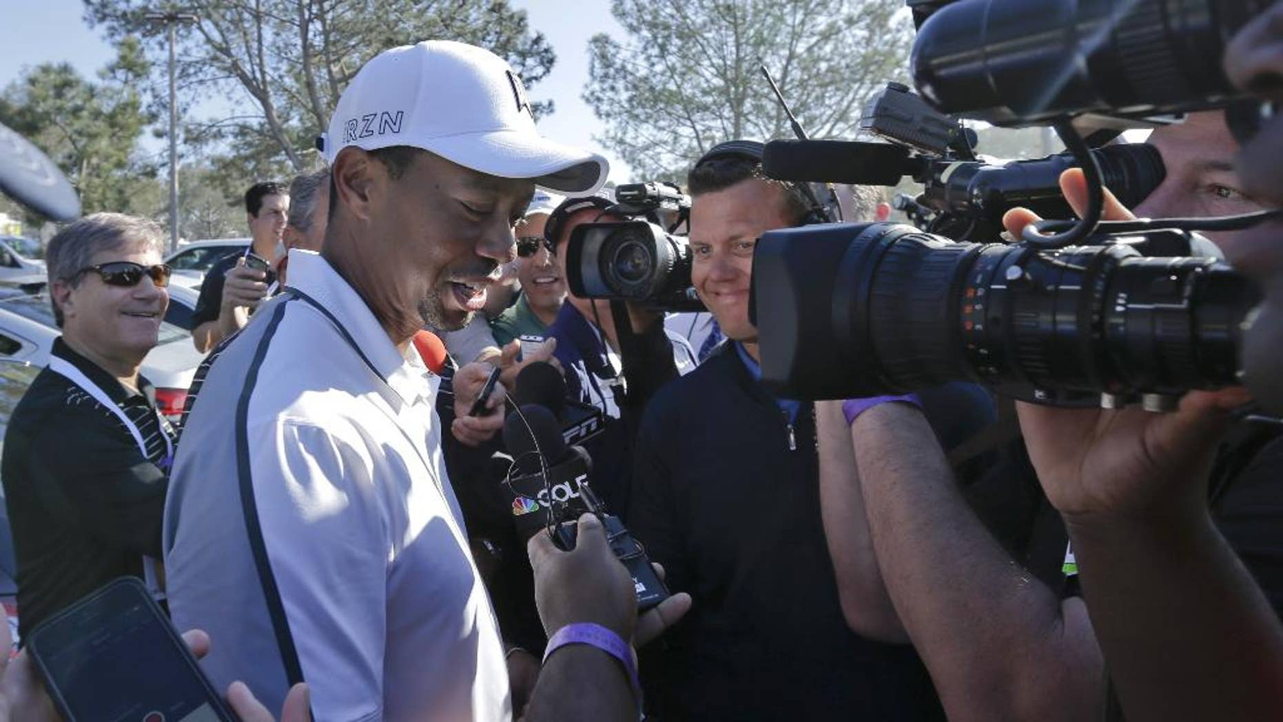 FILE - In this Feb. 5, 2015, file photo, Tiger Woods speaks to reporters after withdrawing during the first round of the Farmers Insurance Open golf tournament in San Diego. Woods won't be at Bay Hill next week for the Arnold Palmer Invitational. He still isn't ruling out the Masters. Woods said on his website Friday, March 13, 2015,  that he will not play at the tournament he has won eight times. (AP Photo/Gregory Bull,, File)