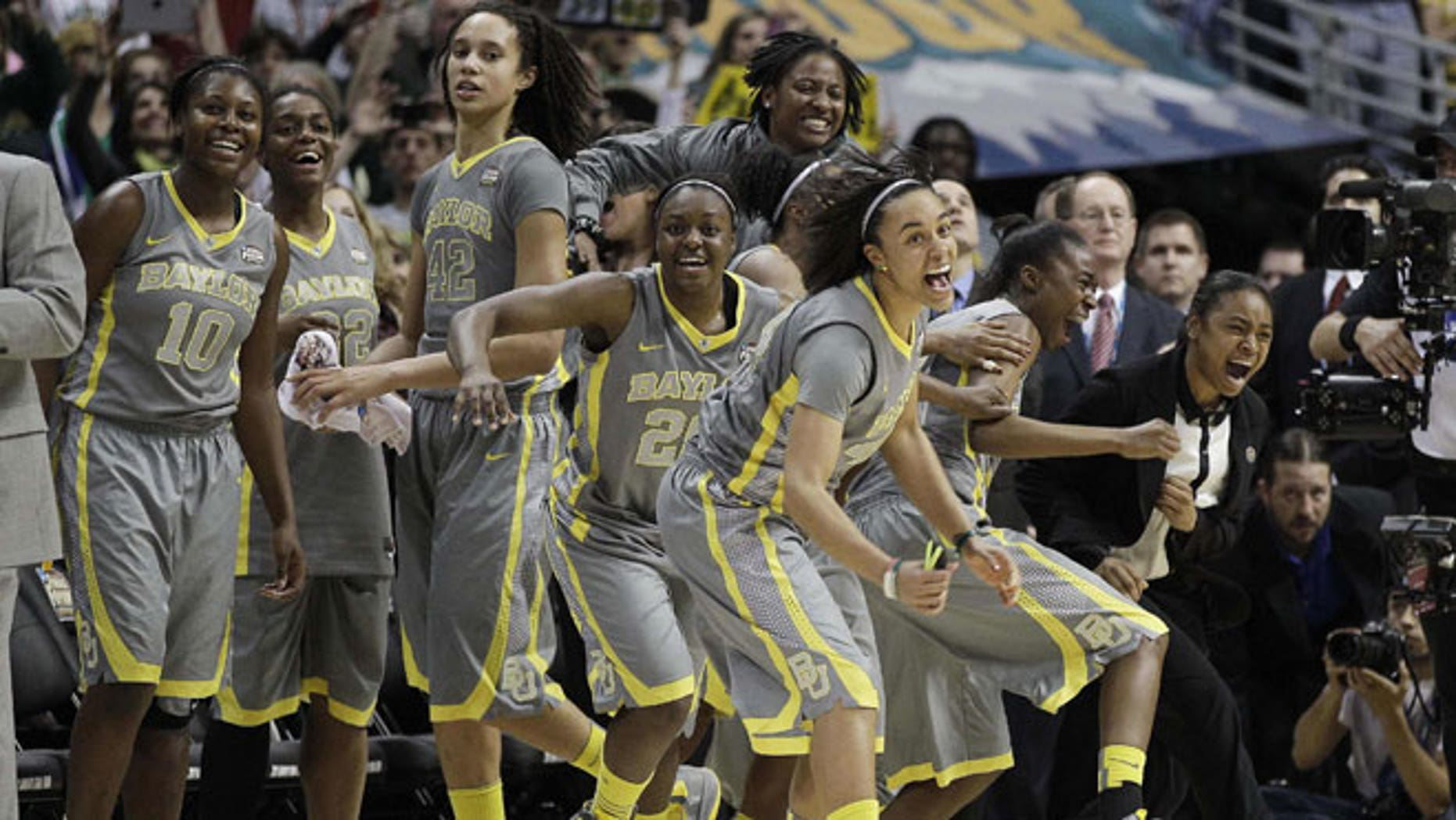 April 3, 2012: The Baylor team explodes off the bench at the end of the second half in the NCAA Women's Final Four college basketball championship game against Notre Dame, in Denver.