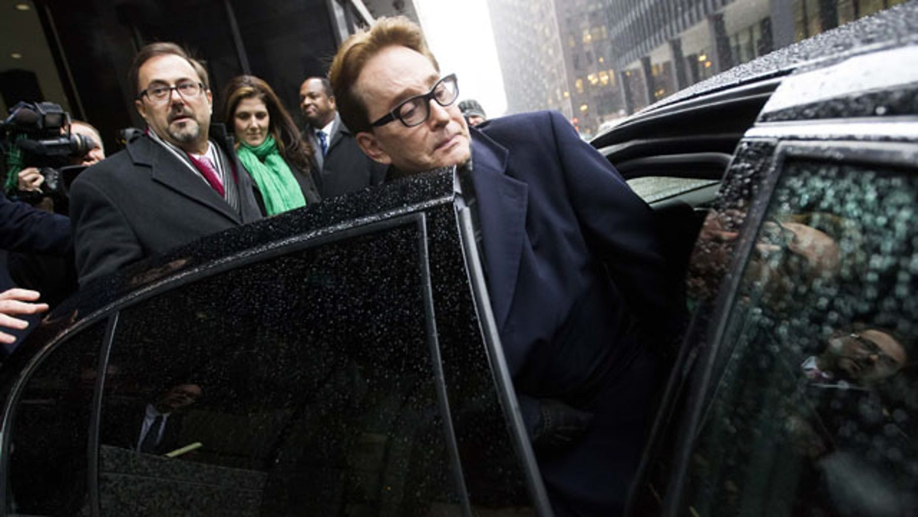 January 14, 2014: H. Ty Warner, the billionaire who created Beanie Babies, gets into a car outside the federal building in Chicago after being sentenced to two years of probation, but no prison time, for tax evasion on $25 million in income he had in Swiss bank accounts. (AP Photo/Andrew A. Nelles)
