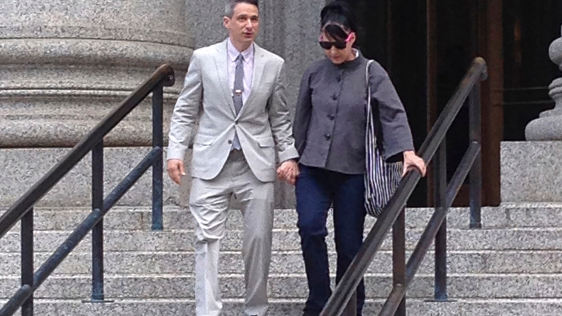 "FILE - In this Tuesday, May 27, 2014 file photo, Beastie Boys rapper Adam ""Ad-Rock"" Horovitz leaves federal court in Manhattan with his wife Kathleen Hanna after testifying at a copyright trial stemming from a lawsuit his musical group brought against a beverage maker over the use of five of their songs in a video, in New York.  The Beastie Boys want to force the maker of Monster Energy drink to pay nearly $2.4 million in legal fees and costs so the rappers $1.7 million jury award is not dwarfed by expenses in a copyright violation case, lawyers say. A Manhattan federal court jury awarded the group most of the $2 million it requested at a 2014 trial, but that was not enough to cover costs that lawyers said were worsened by the actions of the Corona, California-based Monster Energy Co., the musicians lawyers said in papers filed in Manhattan federal court."