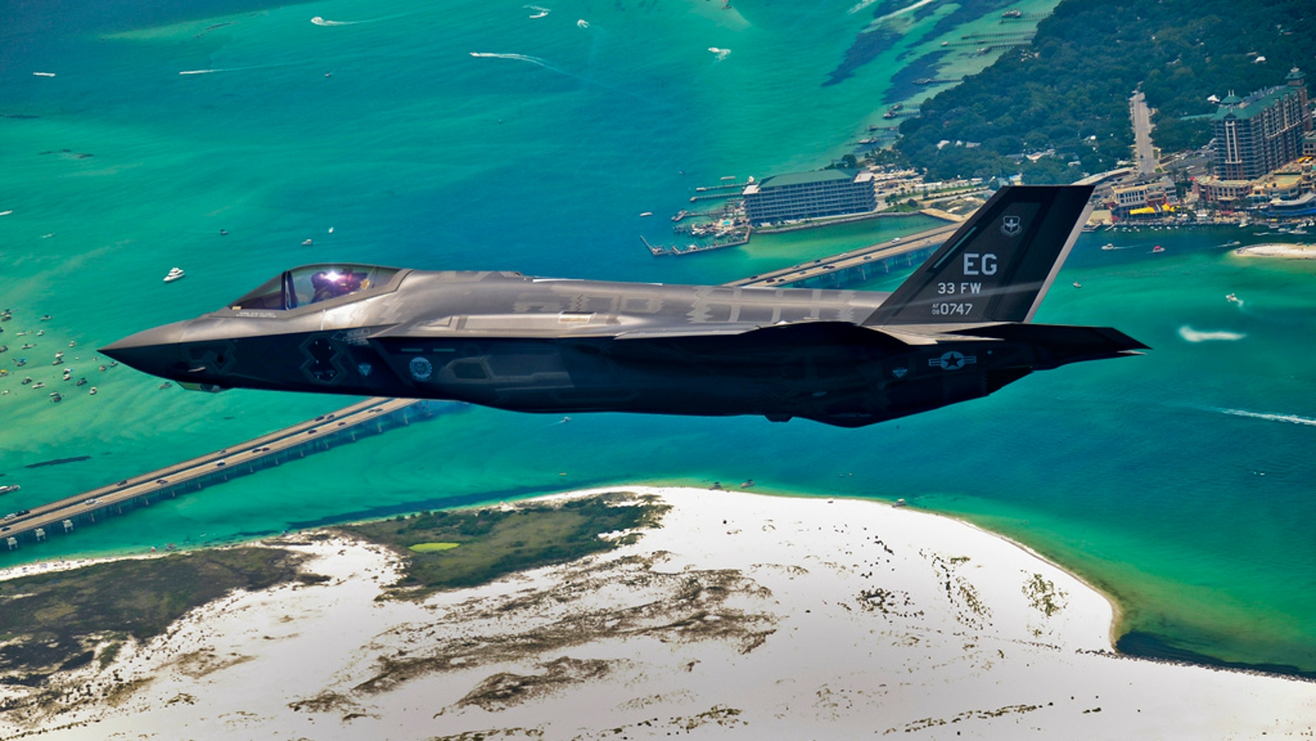 An F-35 Lightning II flies over Destin, Fla., before landing at its new home at Eglin Air Force Base, Fla., July 14, 2011. Its pilot, Lt. Col. Eric Smith is the first Air Force qualified F-35 pilot and is assigned to the 58th Fighter Squadron.