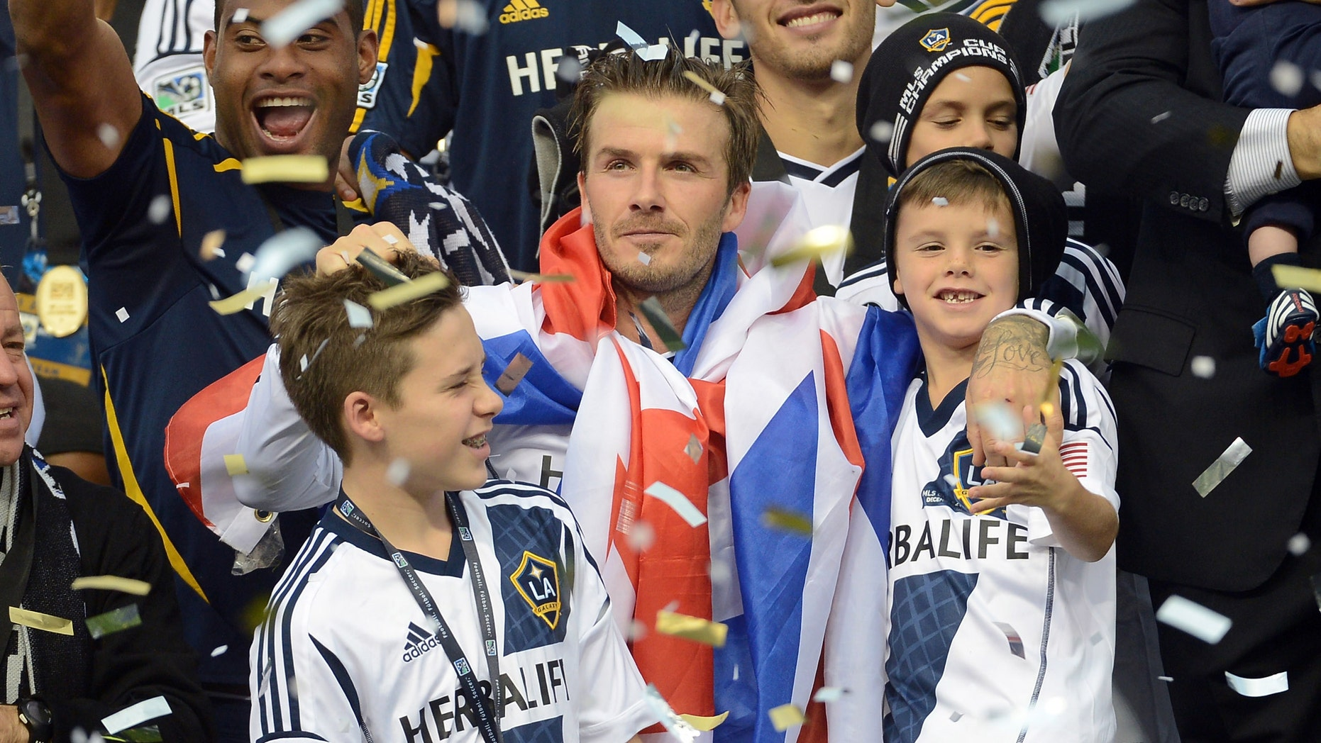 David Beckham #23 of Los Angeles Galaxy celebrates with his sons Brooklyn Beckham, Romeo Beckham and Cruz Bekham after the Galaxy defeat the Houston Dynamo 3-1 to win the 2012 MLS Cup at The Home Depot Center on December 1, 2012 in Carson, California.  (Photo by Harry How/Getty Images)
