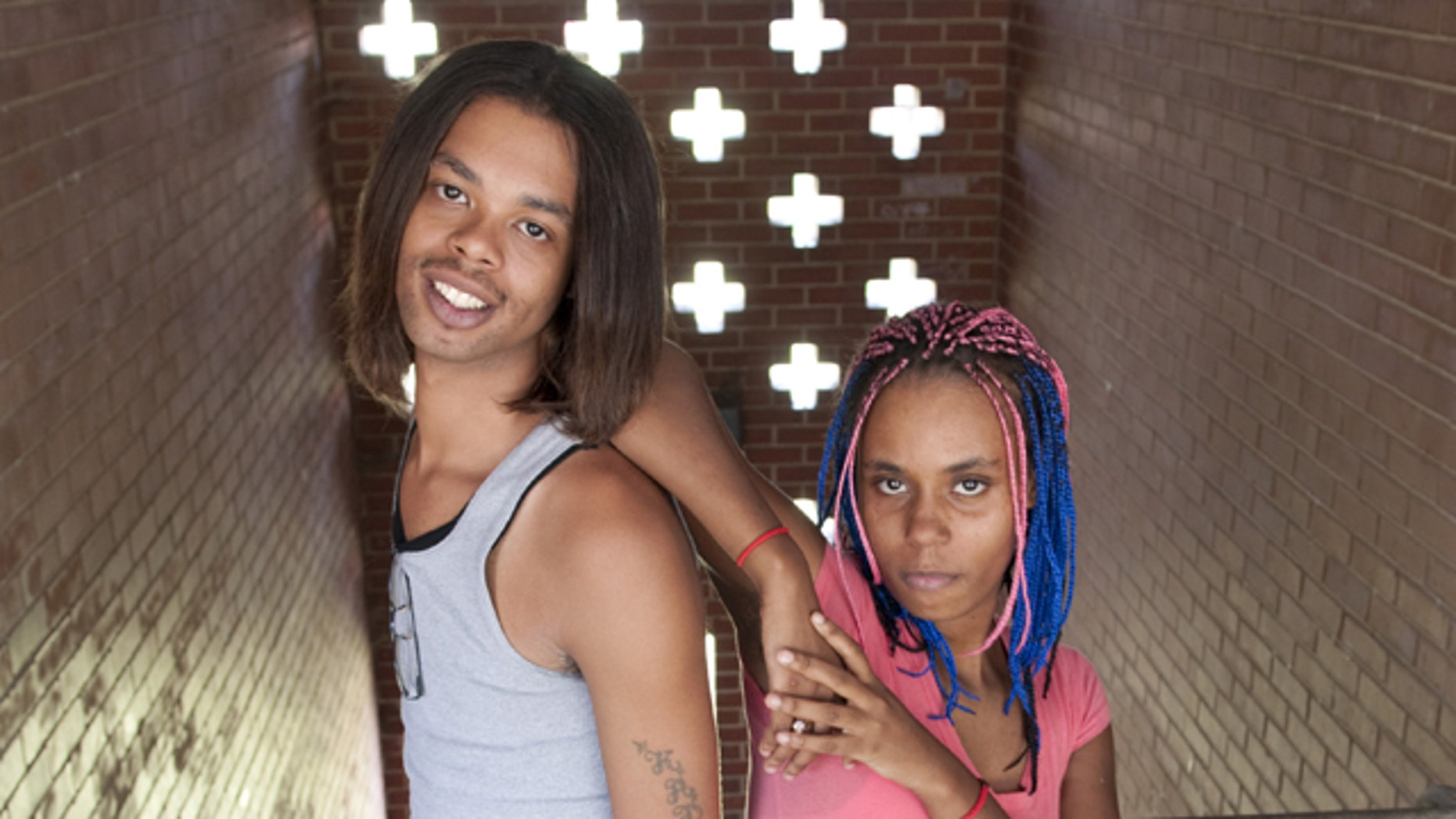 In this photo taken Aug. 27, 2010, Antoine Dodson, 24, and his sister, Kelly Dodson, 22, pose in the stairwell of the apartment complex where Kelly was attacked in Huntsville, Ala. Antoine Dodson's angry, head-shaking TV interview about an attempted rape against his younger sister in her home has turned into a chart-topping iTunes song. Some suggest that the 24-year-old college student's online rant plays to African-American stereotypes.