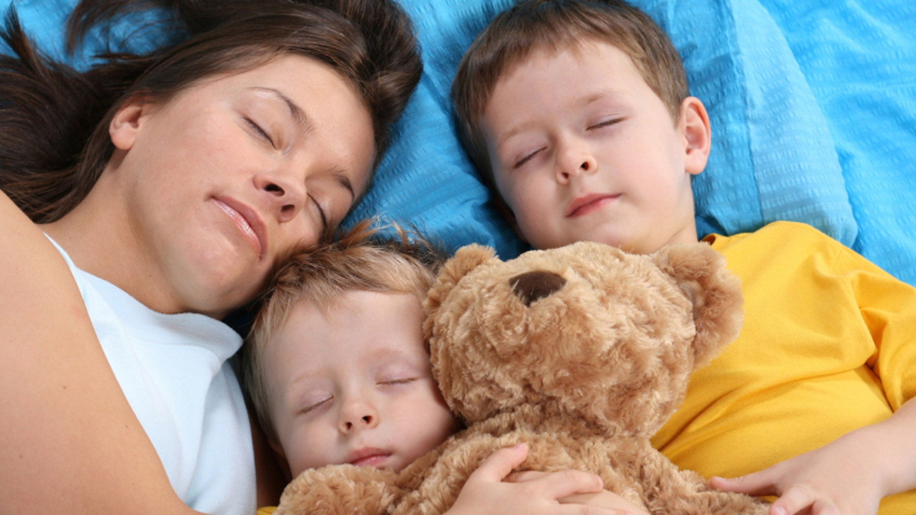sweet dreams - mother and two sons sleeping