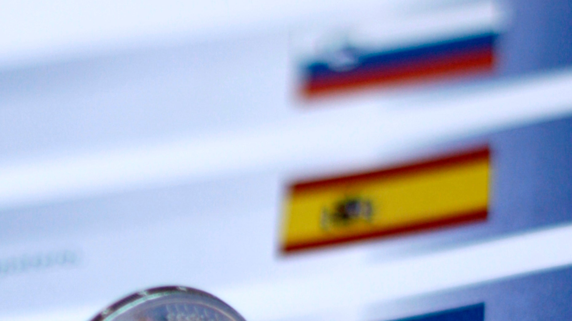 Dec. 9, 2011: One two euro dollar coin is seen on an identification sheet at an EU summit in Brussels.