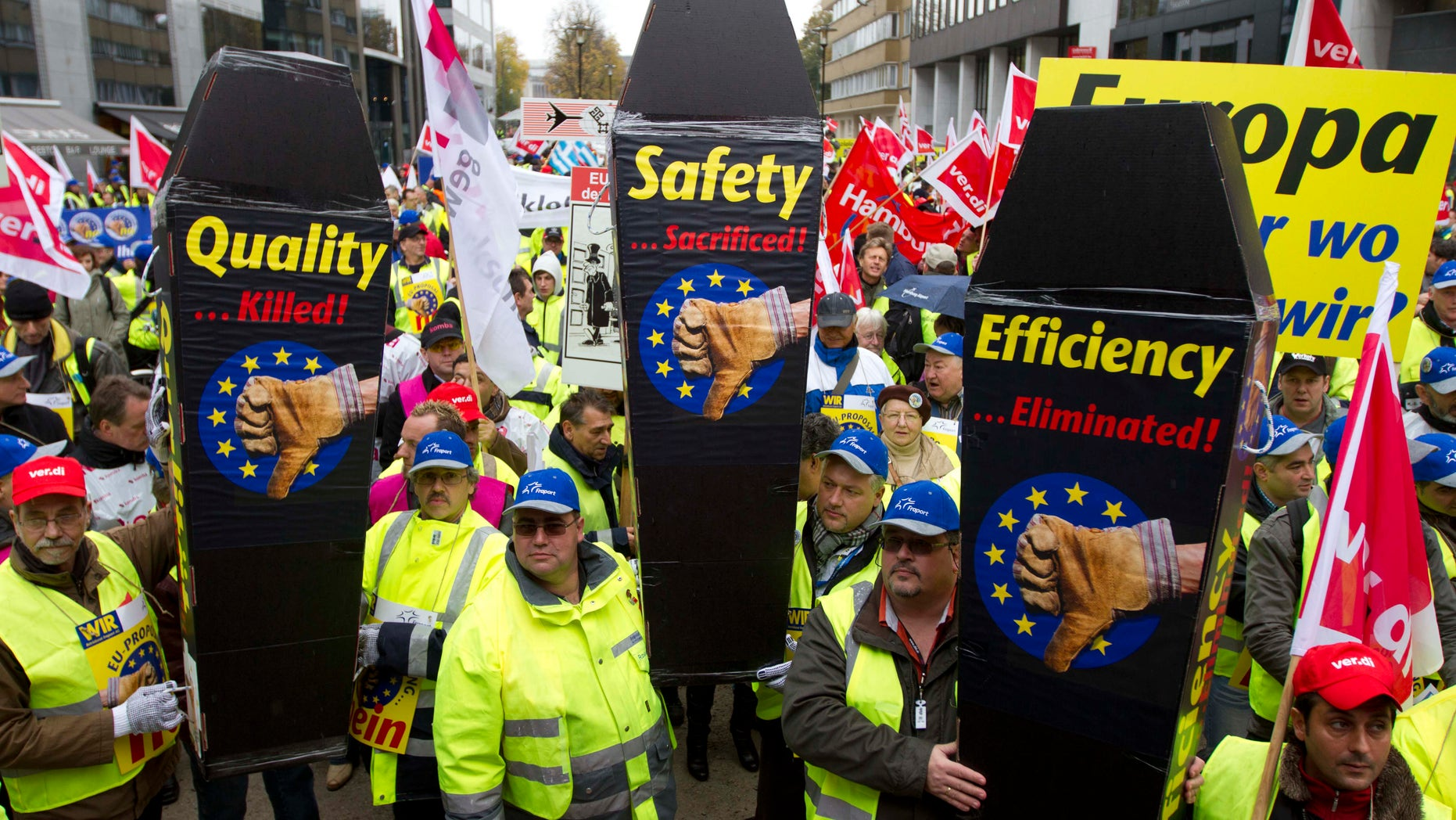 Nov. 5, 2012: Airport ground workers and baggage handlers demonstrate with messages on mock coffins in front of EU headquarters in Brussels.