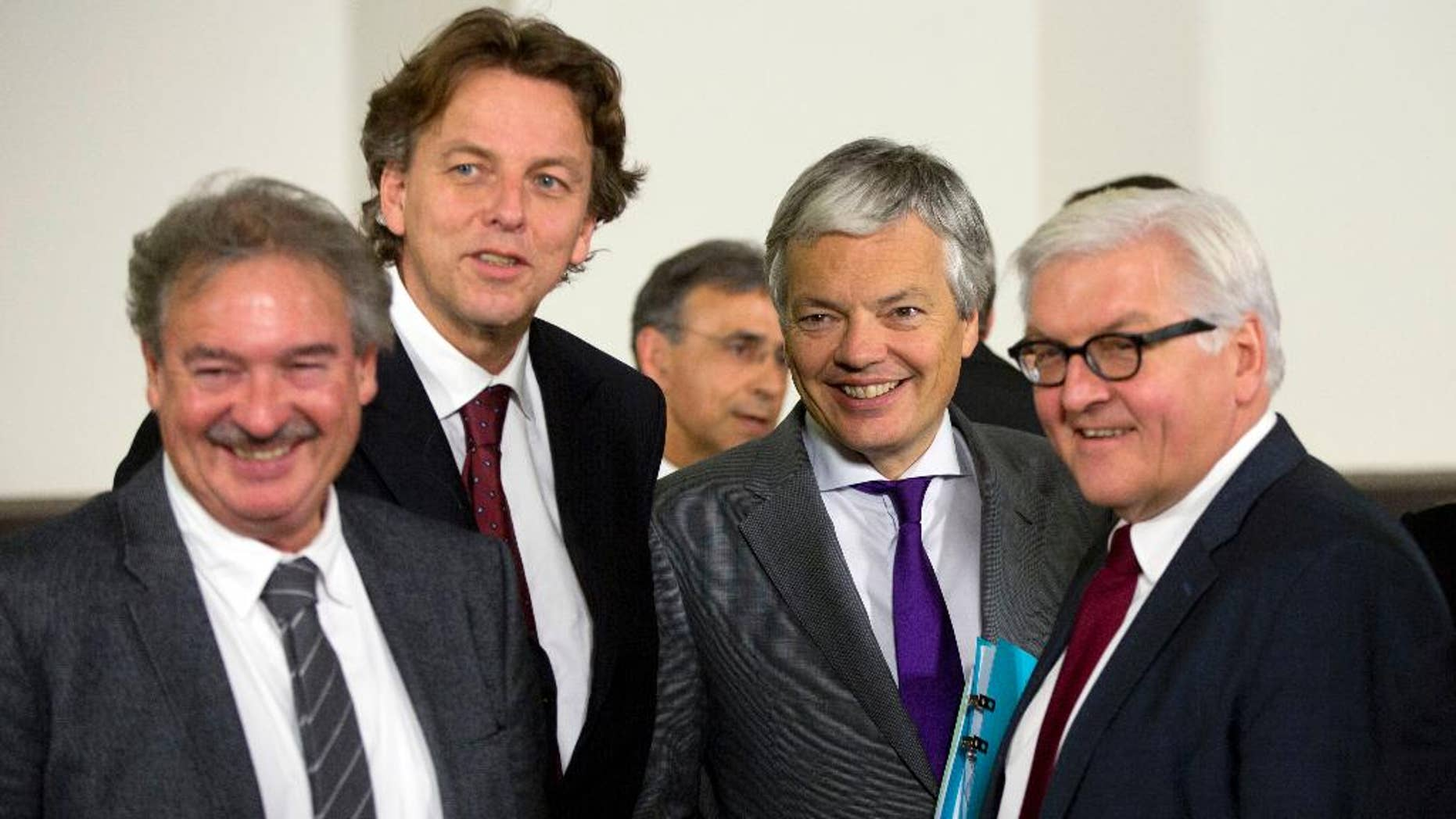 From left, Luxembourg's Foreign Minister Jean Asselborn, Dutch Foreign Minister Bert Koenders, Belgian Foreign Minister Didier Reynders and German Foreign Minister Frank-Walter Steinmeier pose during a group photo at NATO headquarters in Brussels on Tuesday, Dec. 2, 2014. NATO's chief says alliance foreign ministers are poised to make a number of key decisions, including the shift to a non-combat role for NATO-led forces in Afghanistan beginning Jan. 1. 2015. (AP Photo/Virginia Mayo)