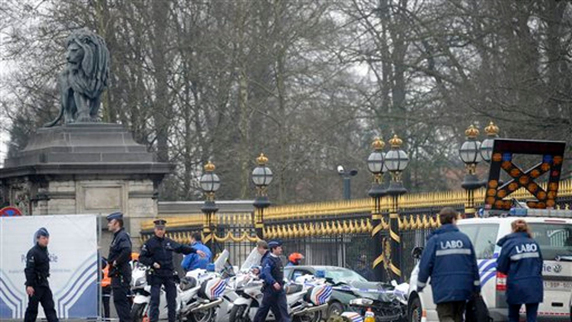 March 13: Police stand at the scene of an accident in front of the Royal Palace in Laeken, Belgium.