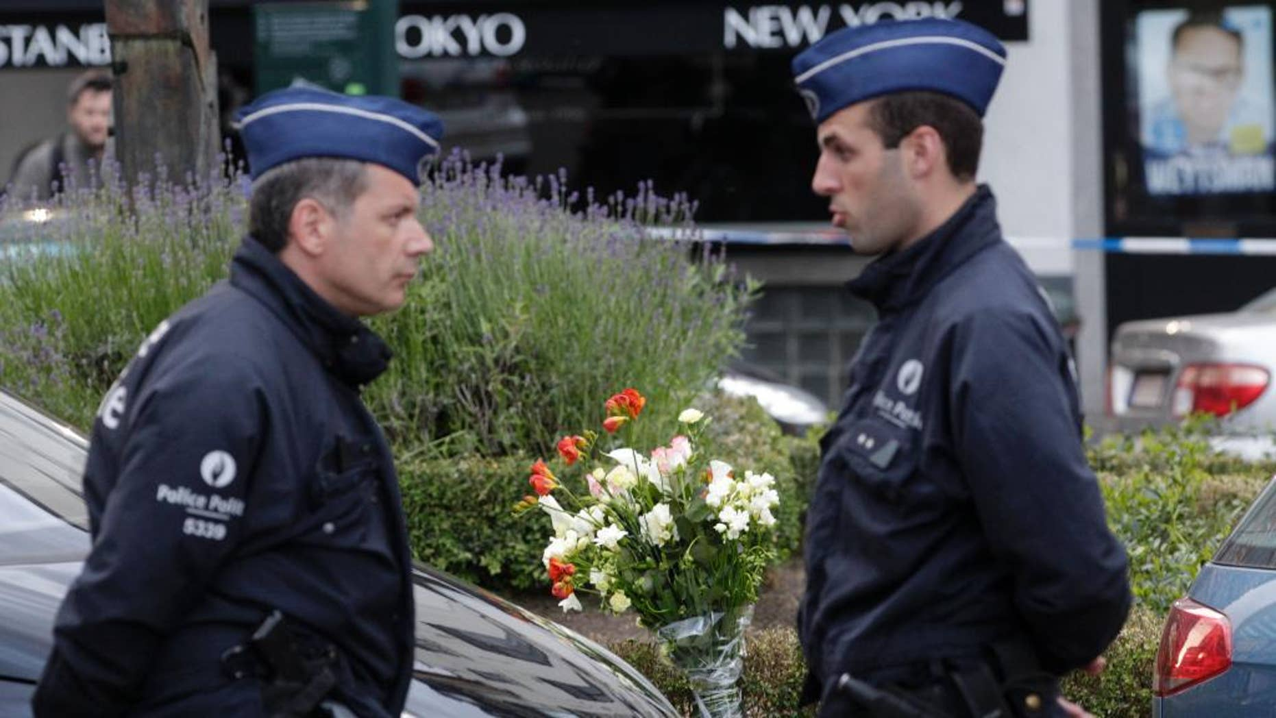 Some flowers were put close to the site of a shooting at the Jewish museum in Brussels, Saturday, May 24, 2014. Three people were killed and one seriously injured in a spree of gunfire at the Jewish Museum in Brussels on Saturday, officials said. The attack, which came on the eve of national and European Parliament elections, led officials to raise anti-terror measures.(AP Photo/Yves Logghe)