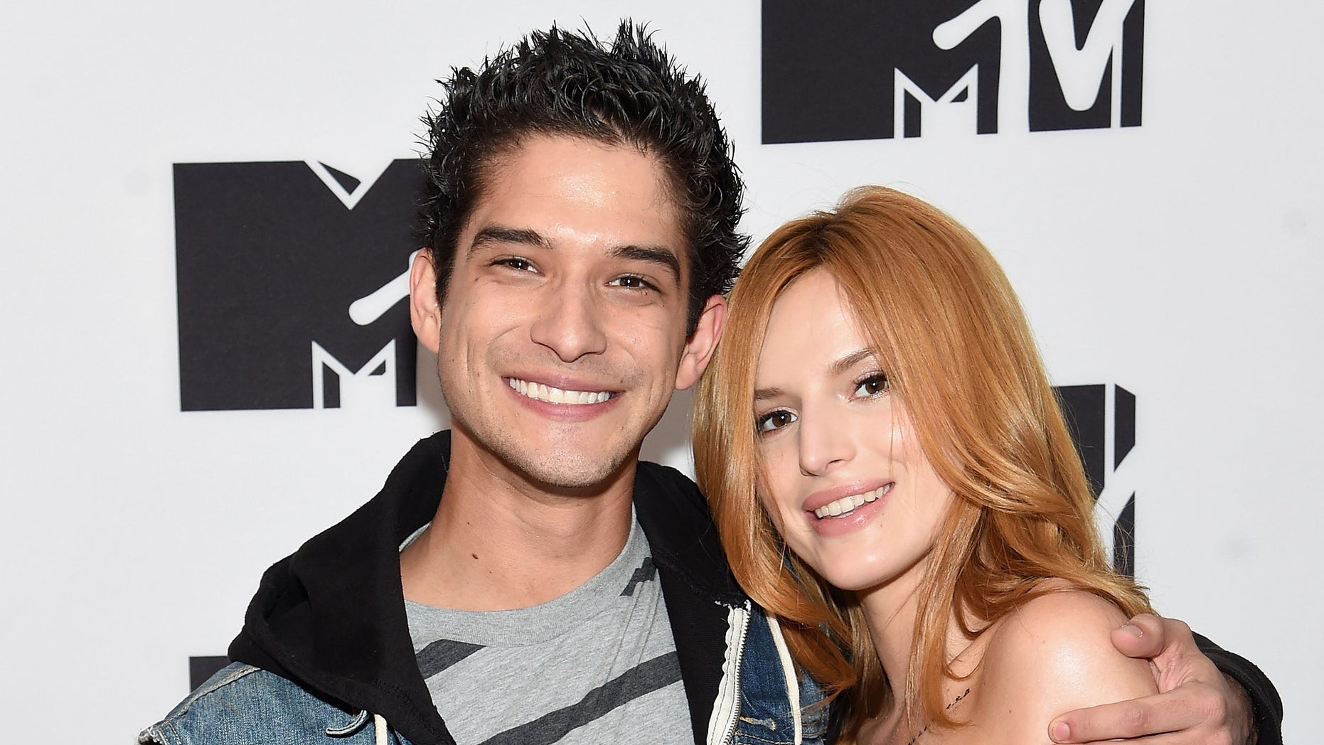 NEW YORK, NY - APRIL 21:  Tyler Posey (L) and Bella Thorne attend the MTV 2015 Upfront presentation on April 21, 2015 in New York City.  (Photo by Jamie McCarthy/Getty Images for MTV)