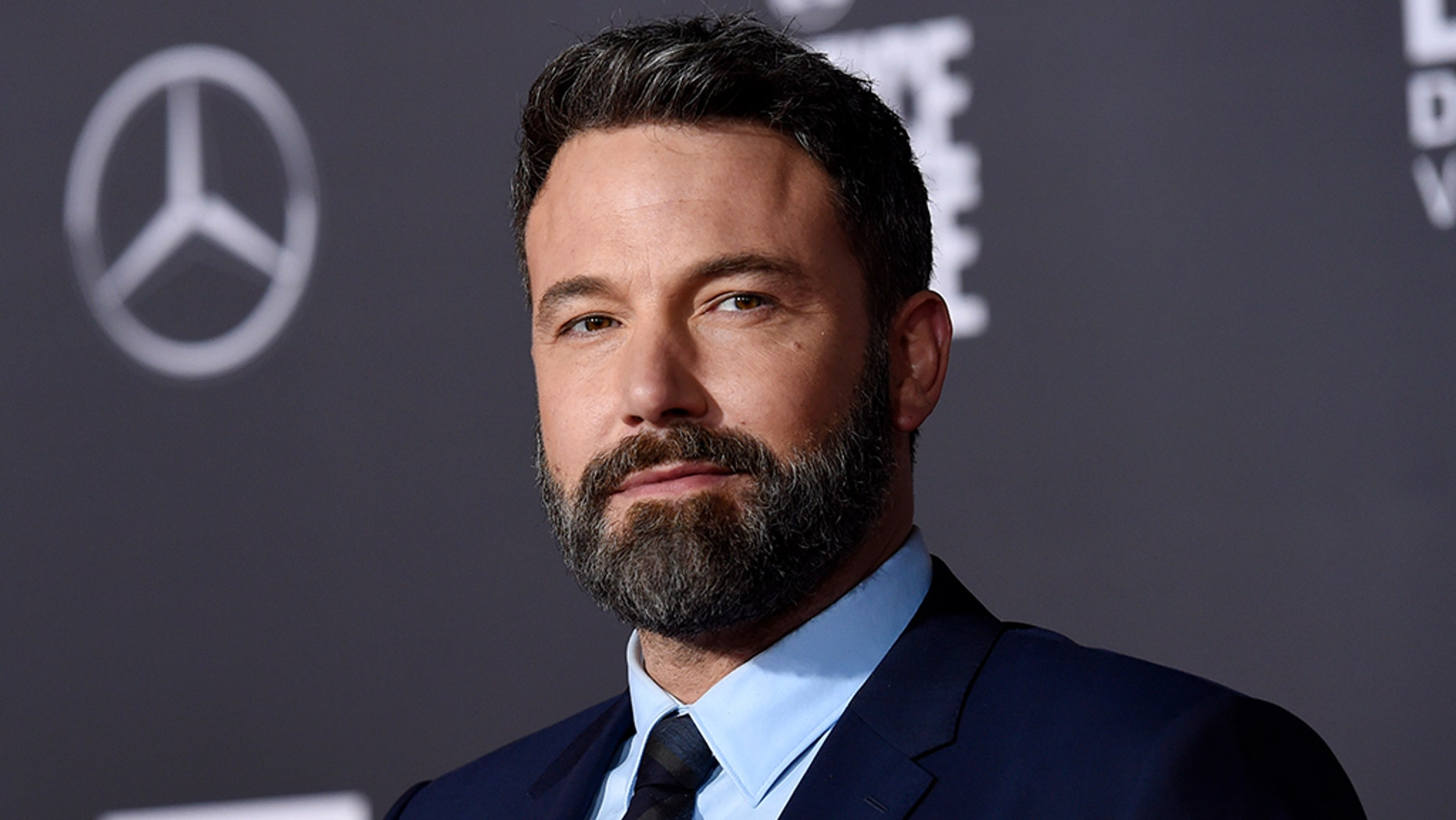 Ben Affleck defended his big tattoo behind him, saying that he loves