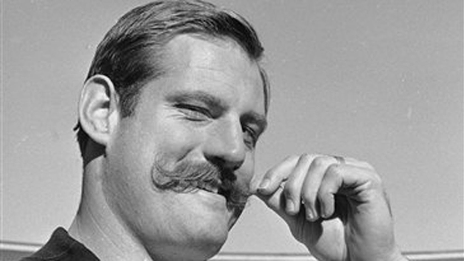 Jan. 3, 1968: In this file photo, Oakland Raiders defensive end Ben Davidson twirls his handlebar moustache in Oakland, Calif., as he contemplated the coming meeting with the Green Bay Packers in the NFL championship game.
