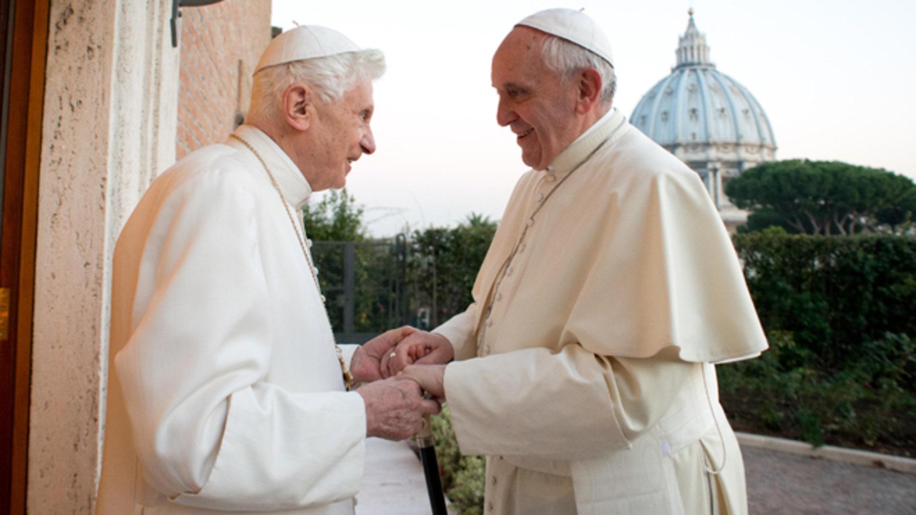 Pope Emeritus Benedict XVI and Pope Francis exchange Christmas greetings on Dec. 23, 2013.