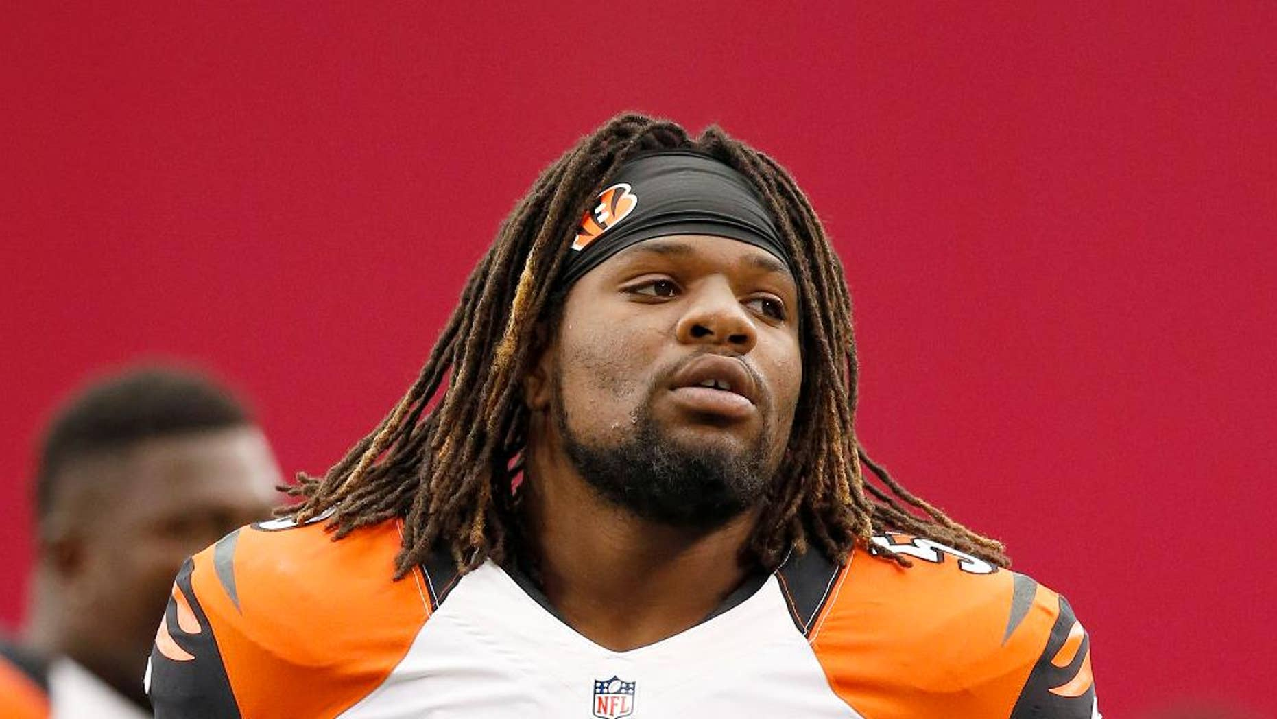 FILE - In this Aug. 24, 2014, file photo, Cincinnati Bengals' Vontaze Burfict stretches out with teammates prior to an NFL preseason football game against the Arizona Cardinals in Glendale, Ariz. Burfict had surgery to clean out his left knee on Wednesday, Oct. 29, 2014,  and will miss at least the next two games. (AP Photo/Ross D. Franklin, File)
